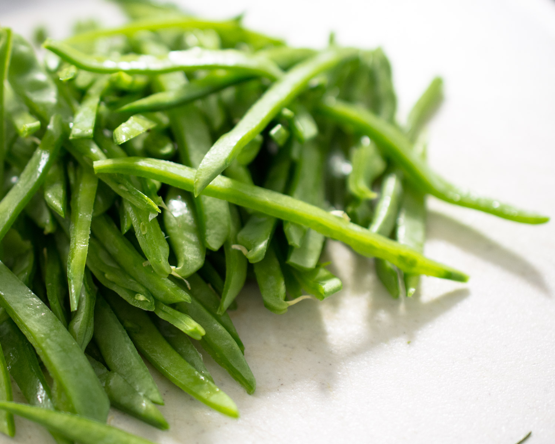 Thinly sliced garden fresh snow peas.