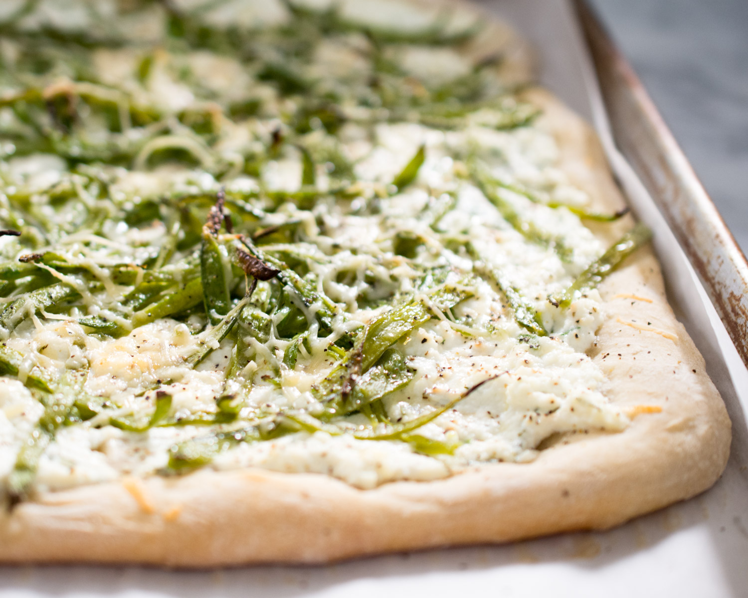 Pea and herbed ricotta pizza - just out of the oven!
