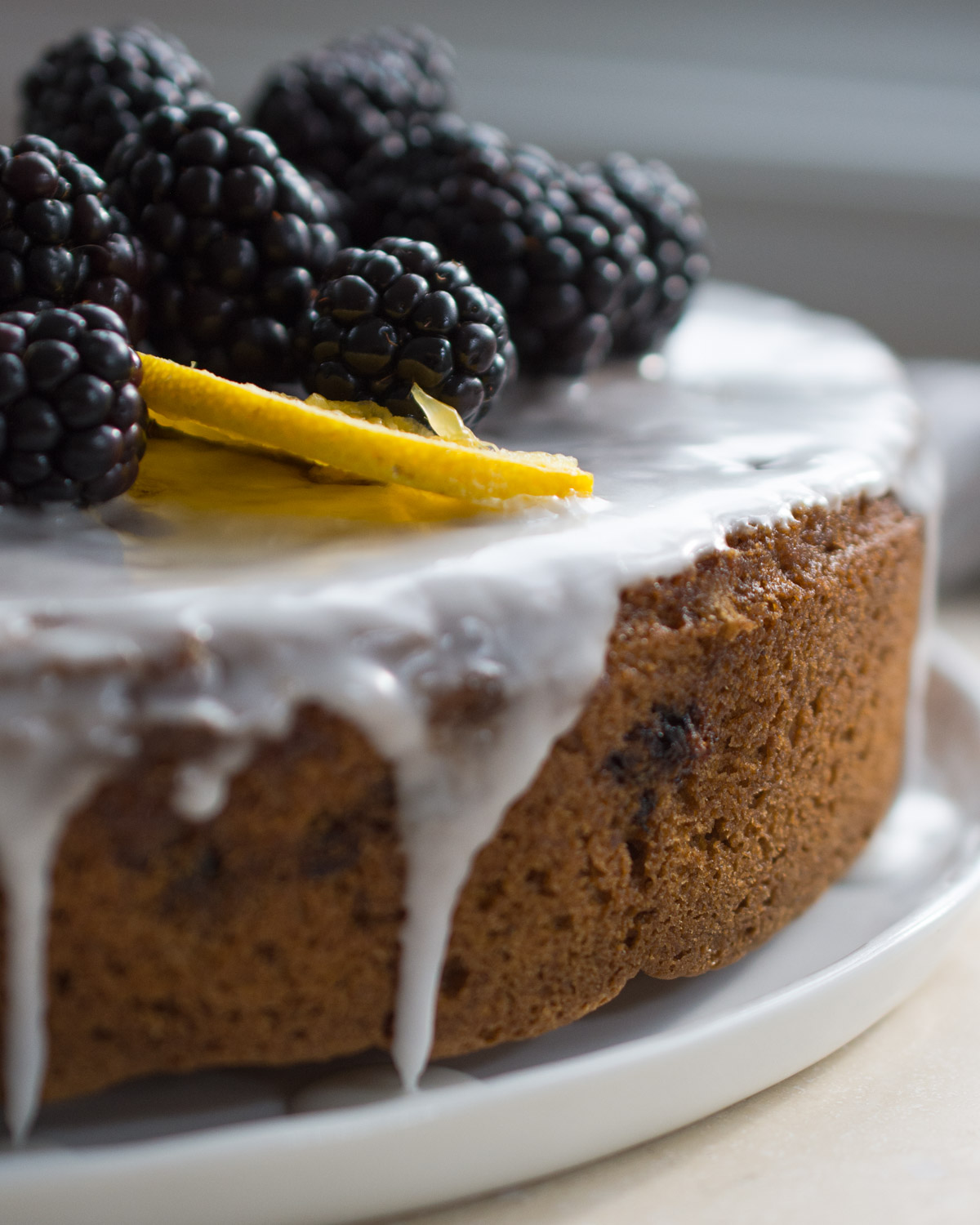 Orange Blackberry Olive Oil Cake with fresh blackberry garnish.