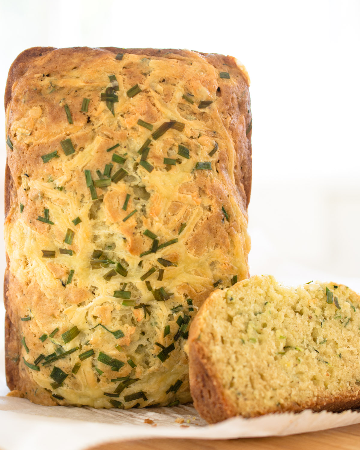 Cheesy Zucchini Bread topped with chives.