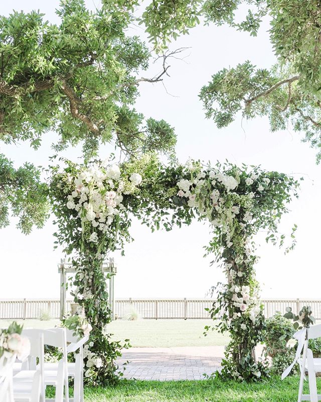 Ceremony arbor under the oaks on the lawn at The Grand Hotel. This is a view that never gets old!