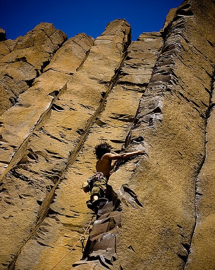 A climber tackles one of the beautiful Basalt Pillars the area is know for.  Source.