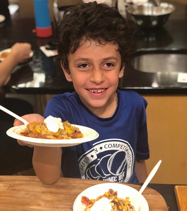 """If you were at @kingsfoodmarket in Short Hills, NJ, today... you met Nico! He was helping me serve bucatini with corn, tomatoes, pancetta, breadcrumbs and burrata...one of my favorites from the Pasta Friday Cookbook. He kept telling me...""""mama, I got this, you take a break."""" 🤣🤣❤️"""
