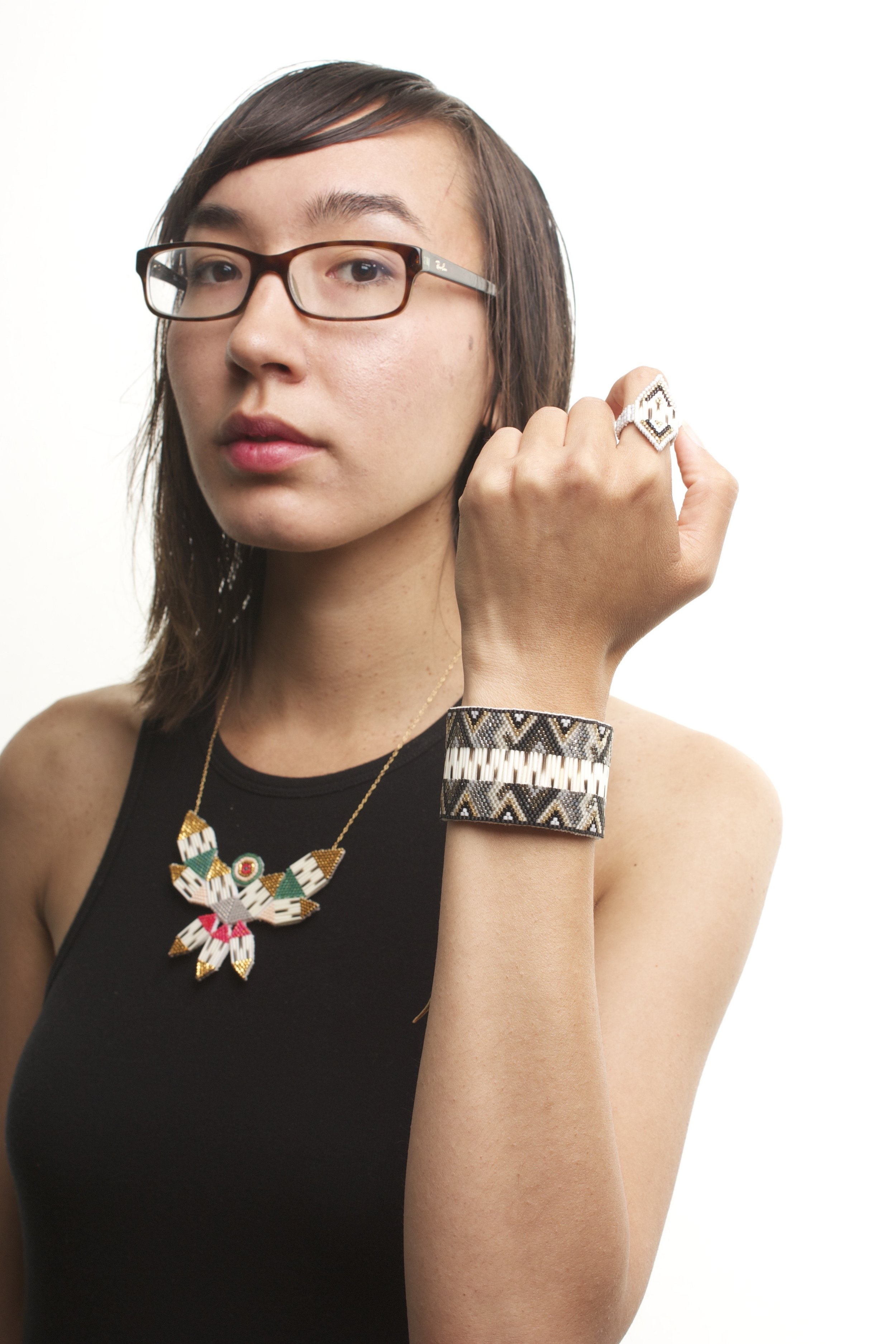 Jewelley: Thunderbird necklace, Beaded & Quill Cuff, Shield Ring. Photo Courtesy of GNWT Arts