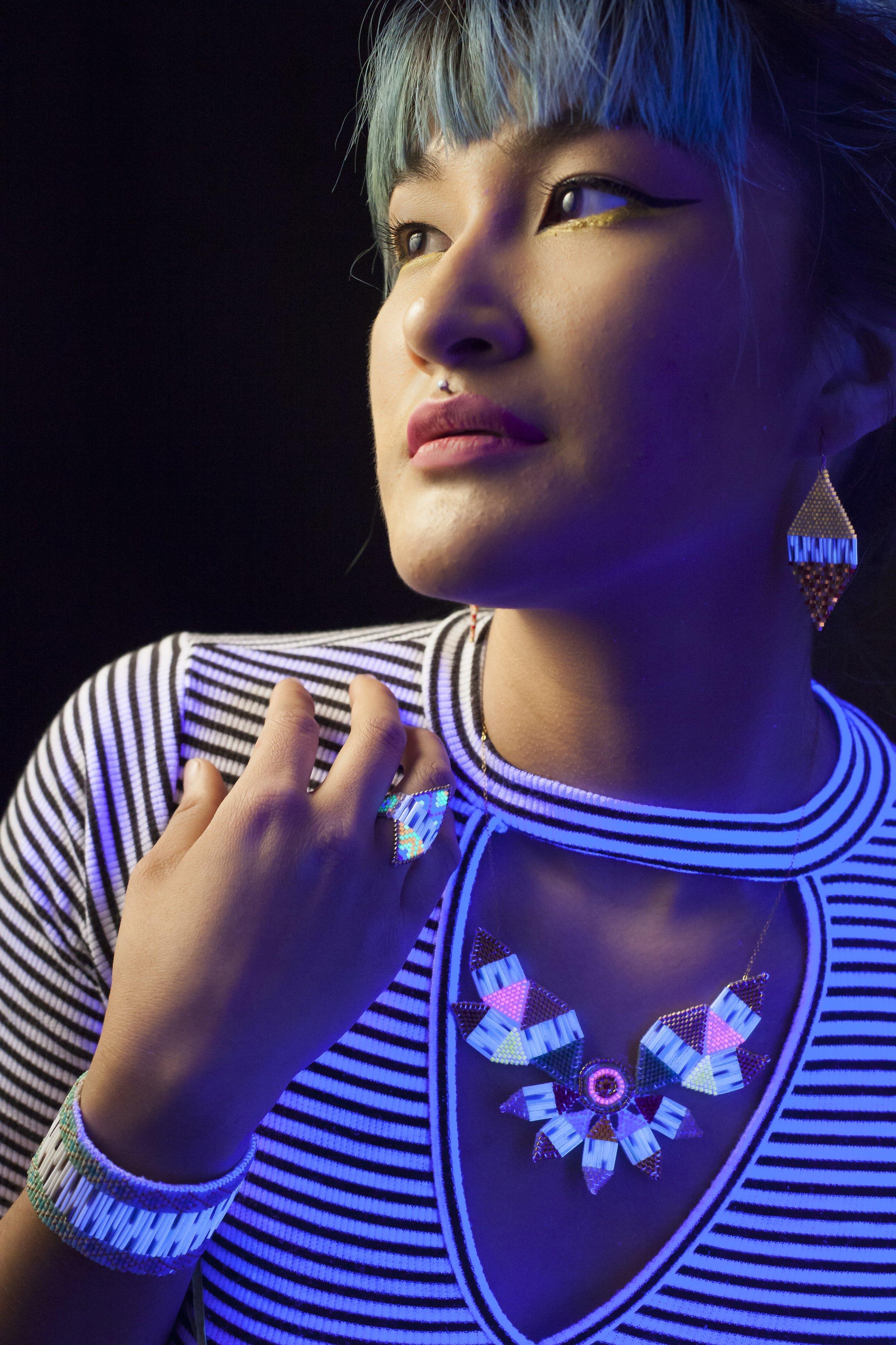 Jewellery; Neon Ookpik Necklace, Neon Beaded Cuff, Neon Shield Earrings. Photo Courtesy of Jaida Greyeagle.