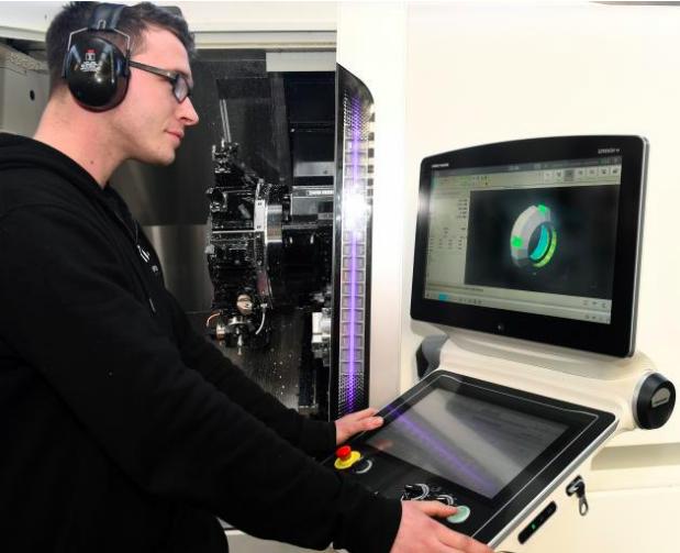 Mike Thompson programmes the semi-automated twin spindle lathe DMG Mori NLX 2500, bought for the TASKA partnership.