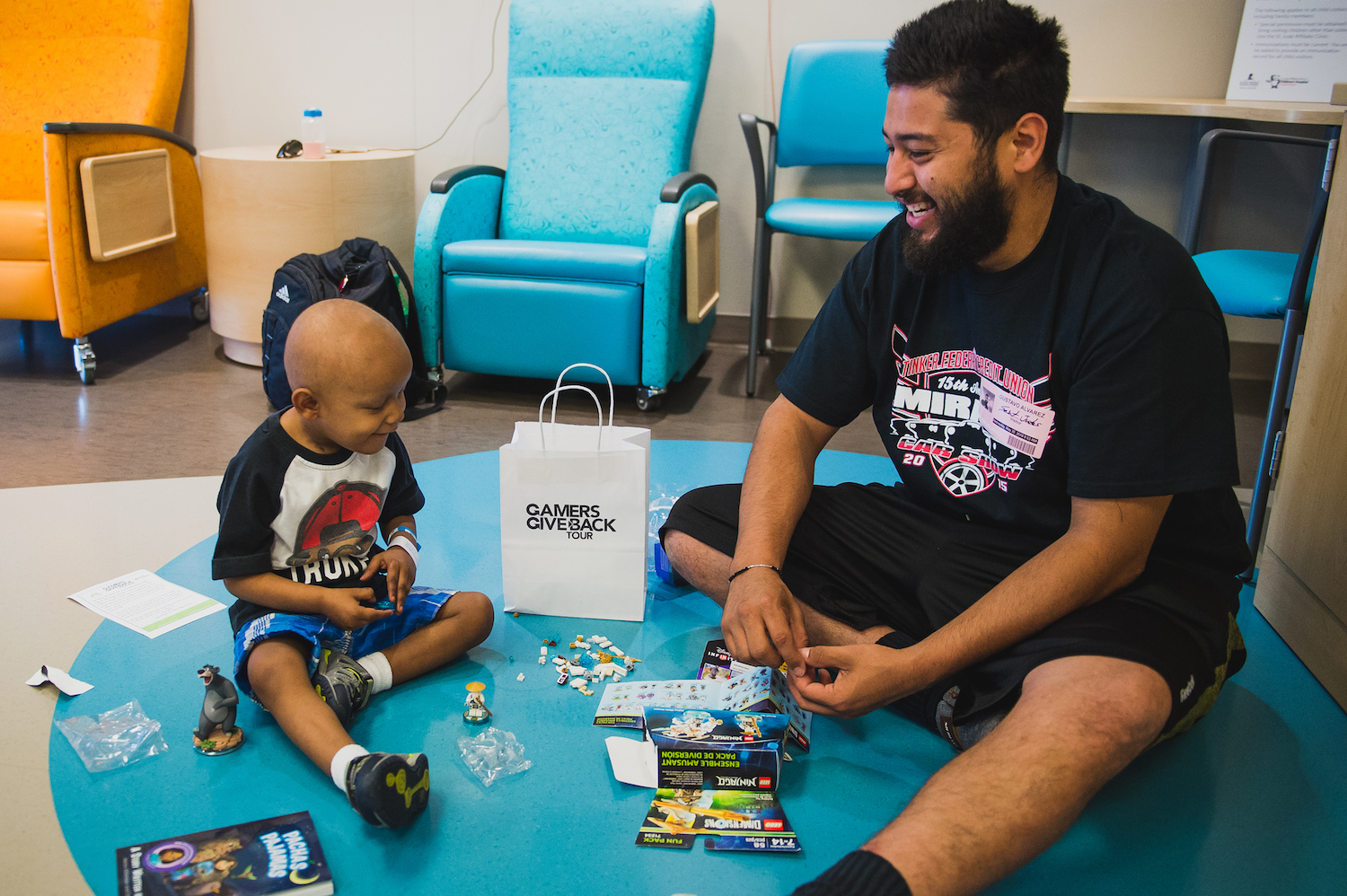 Boy Patient and his Father with GameChanger Charity Gift Bag.jpg