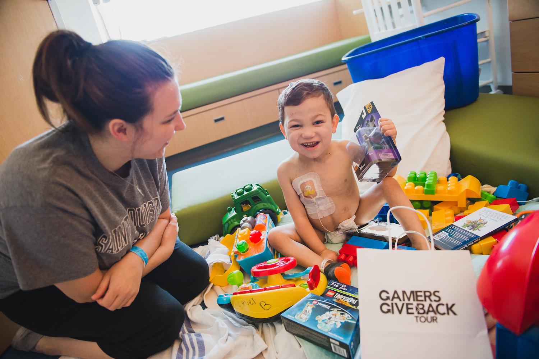 Hospitalized Boy Opens GameChanger Charity Gift Bag.jpg