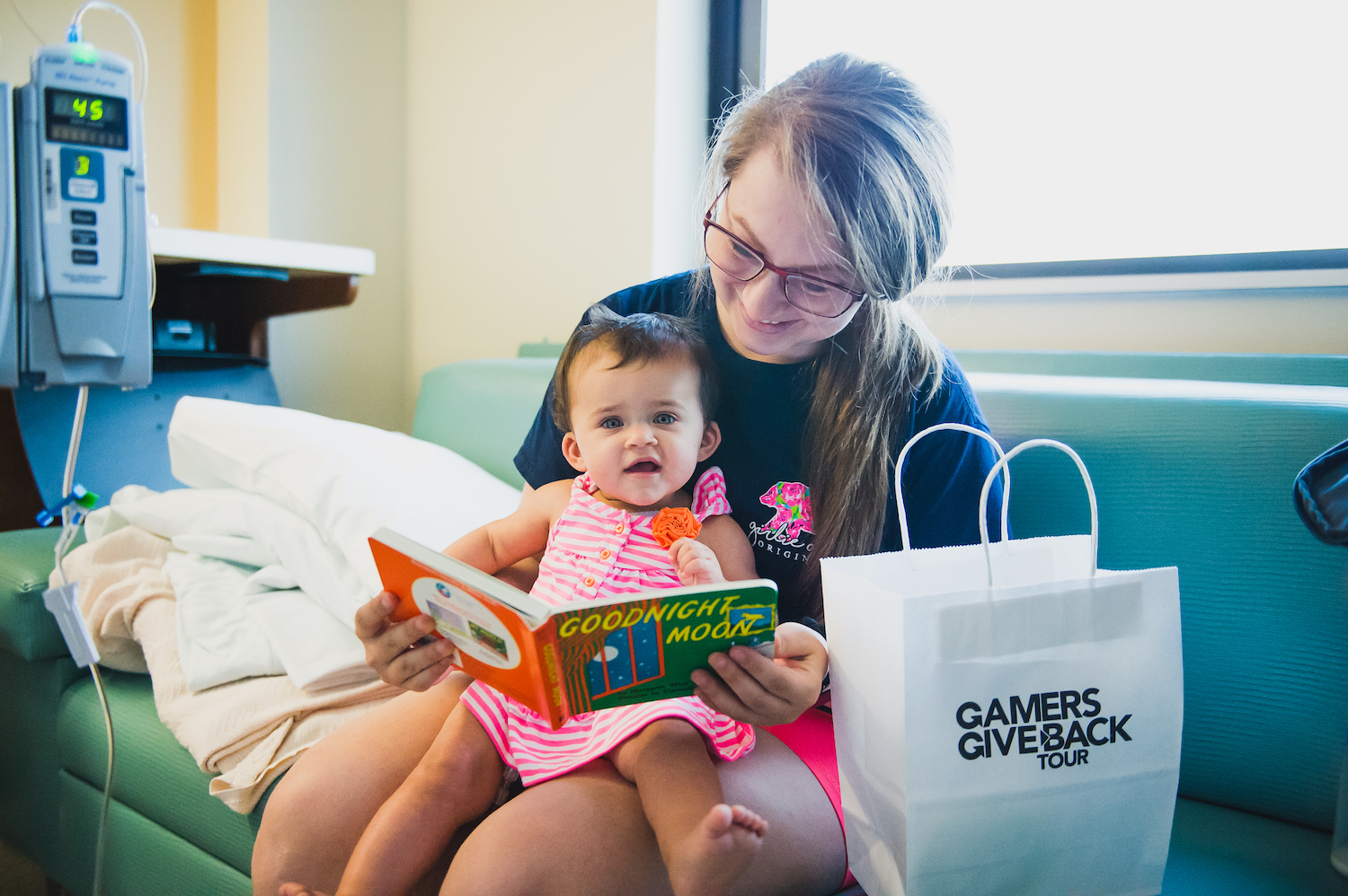 Infant Pediatric Patient with a GameChanger Charity Gift Bag.jpg