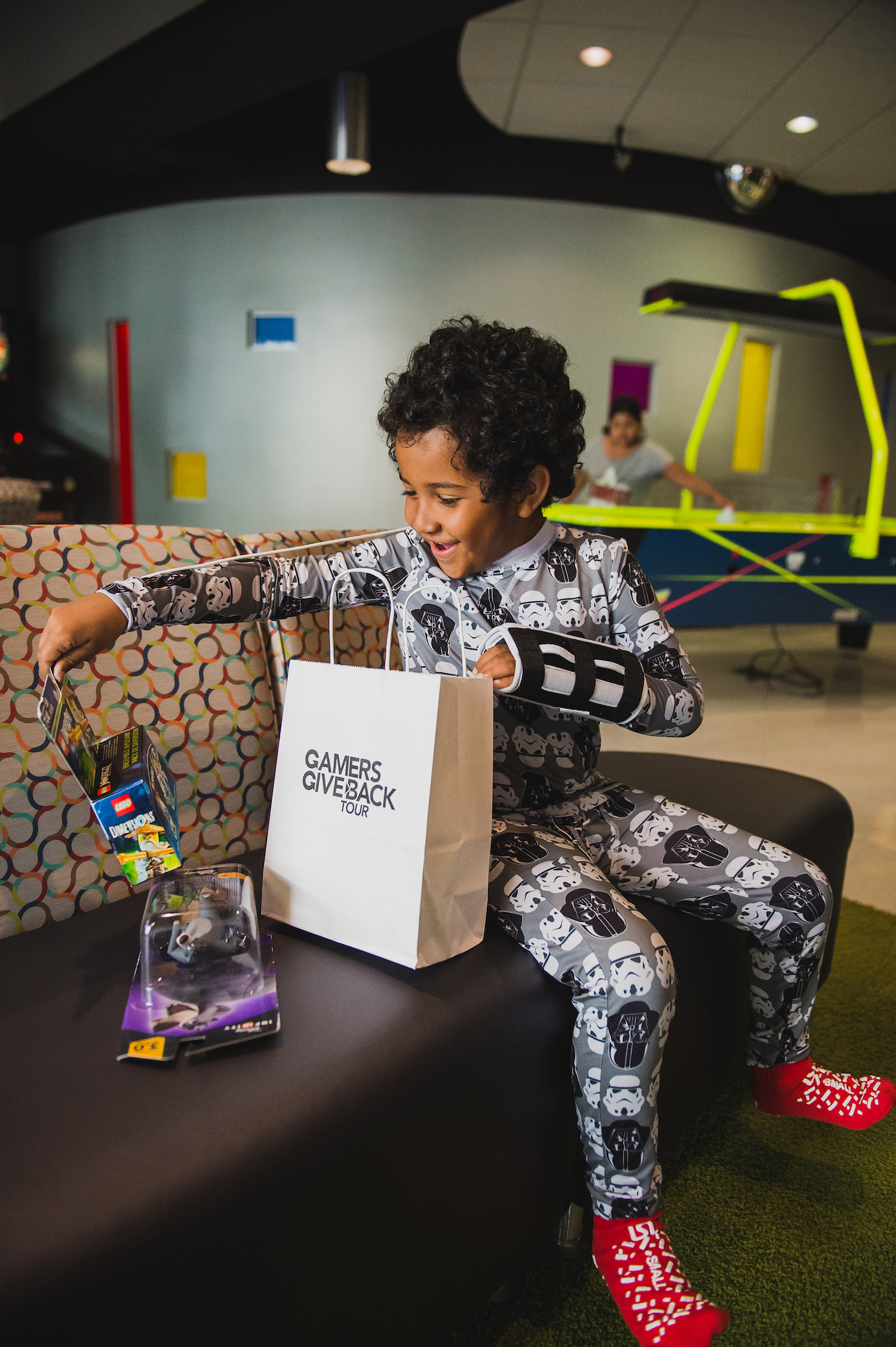 Male Pediatric Patient Excitedly Opens a GameChanger Charity Gift Bag.jpg