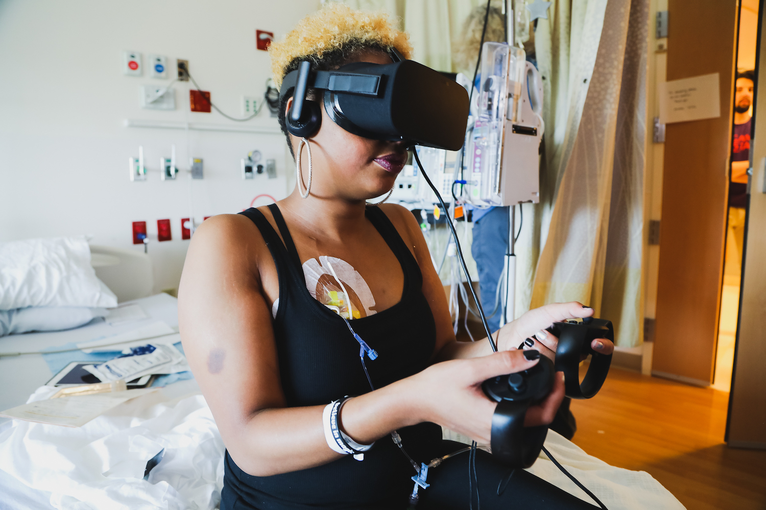 Teenage Patient Plays with GameChanger Charity Virtual Reality Game.jpg