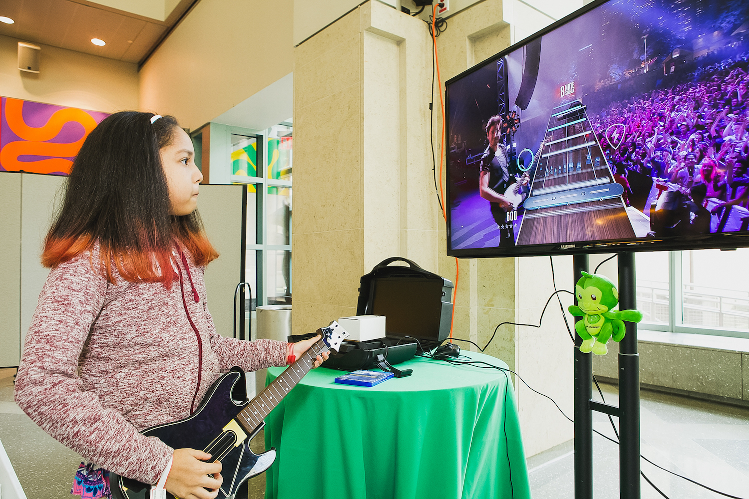 Young Girl Plays Guitar Hero during GameChanger Charity Play Day.jpg