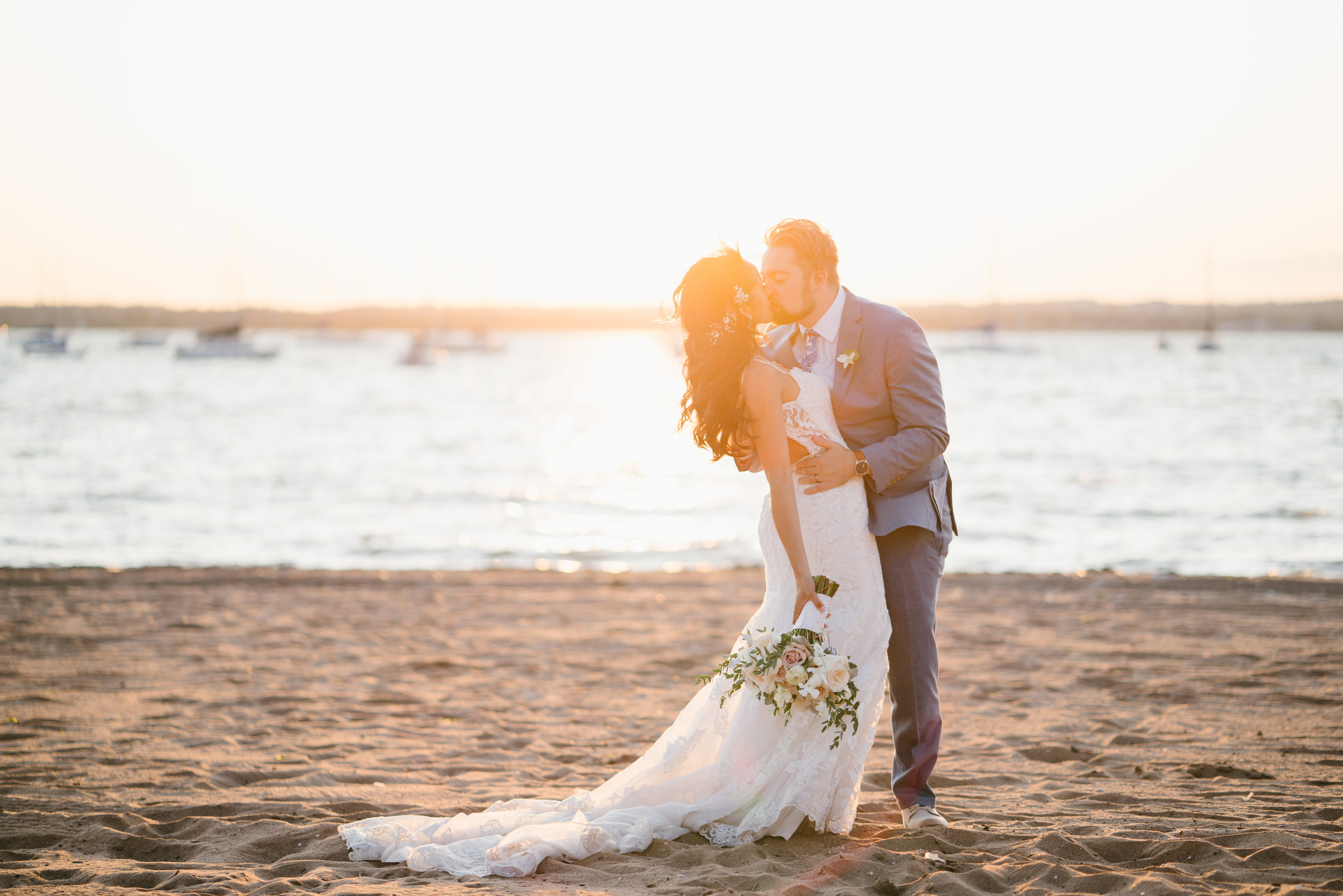 sunset photo of bride and groom on beach in Malibu
