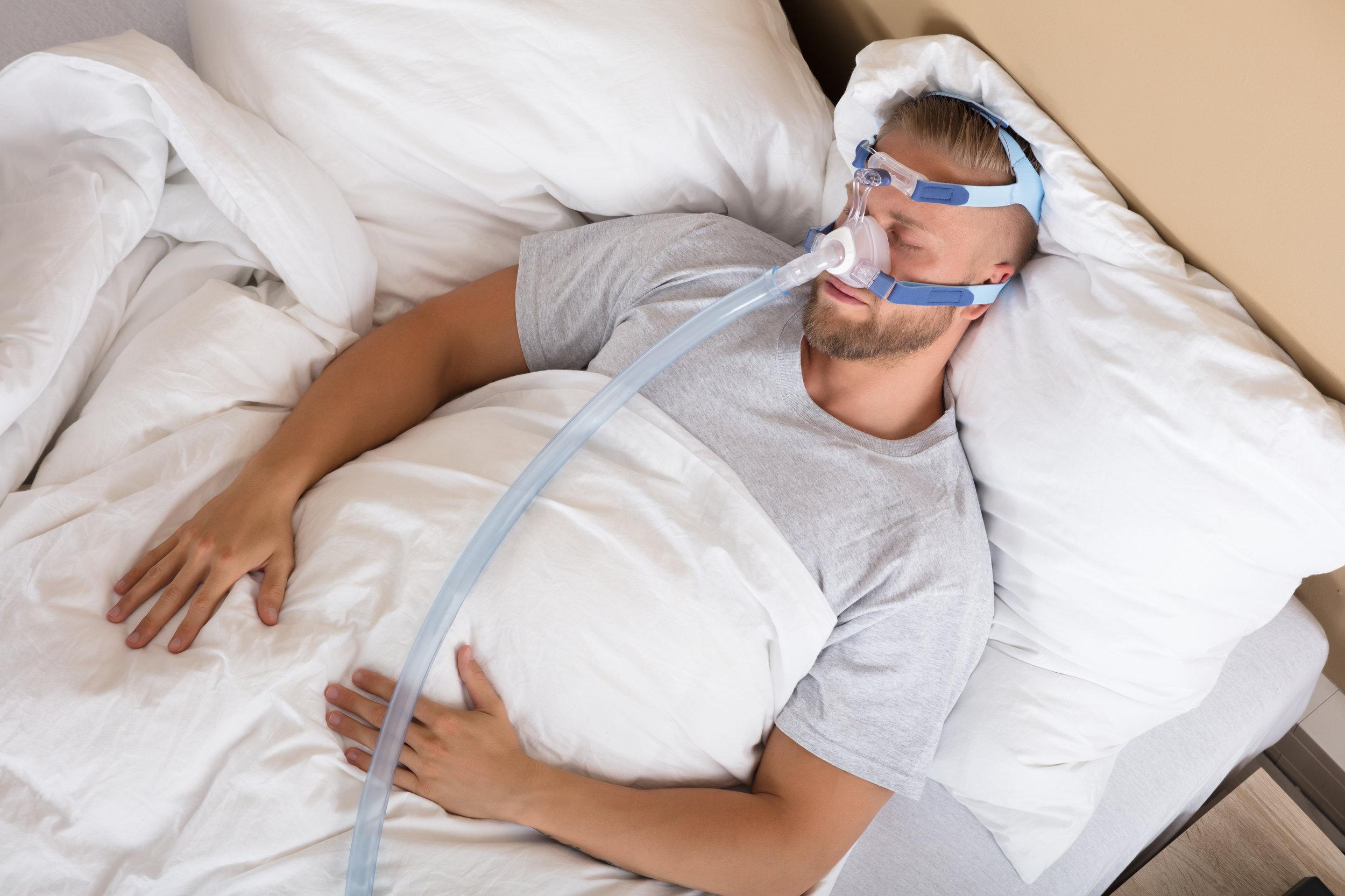 man with cpap machine for sleep apnea