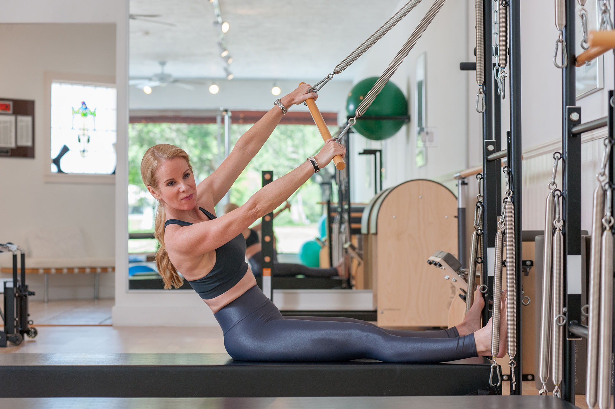 Pilates Works of Sarasota studio, a fully equipped Pilates studio in Sarasota, FL, including Pilates Stability Chairs, WALL UNIT, AND LADDER BARREL PILATES EQUIPMENT.