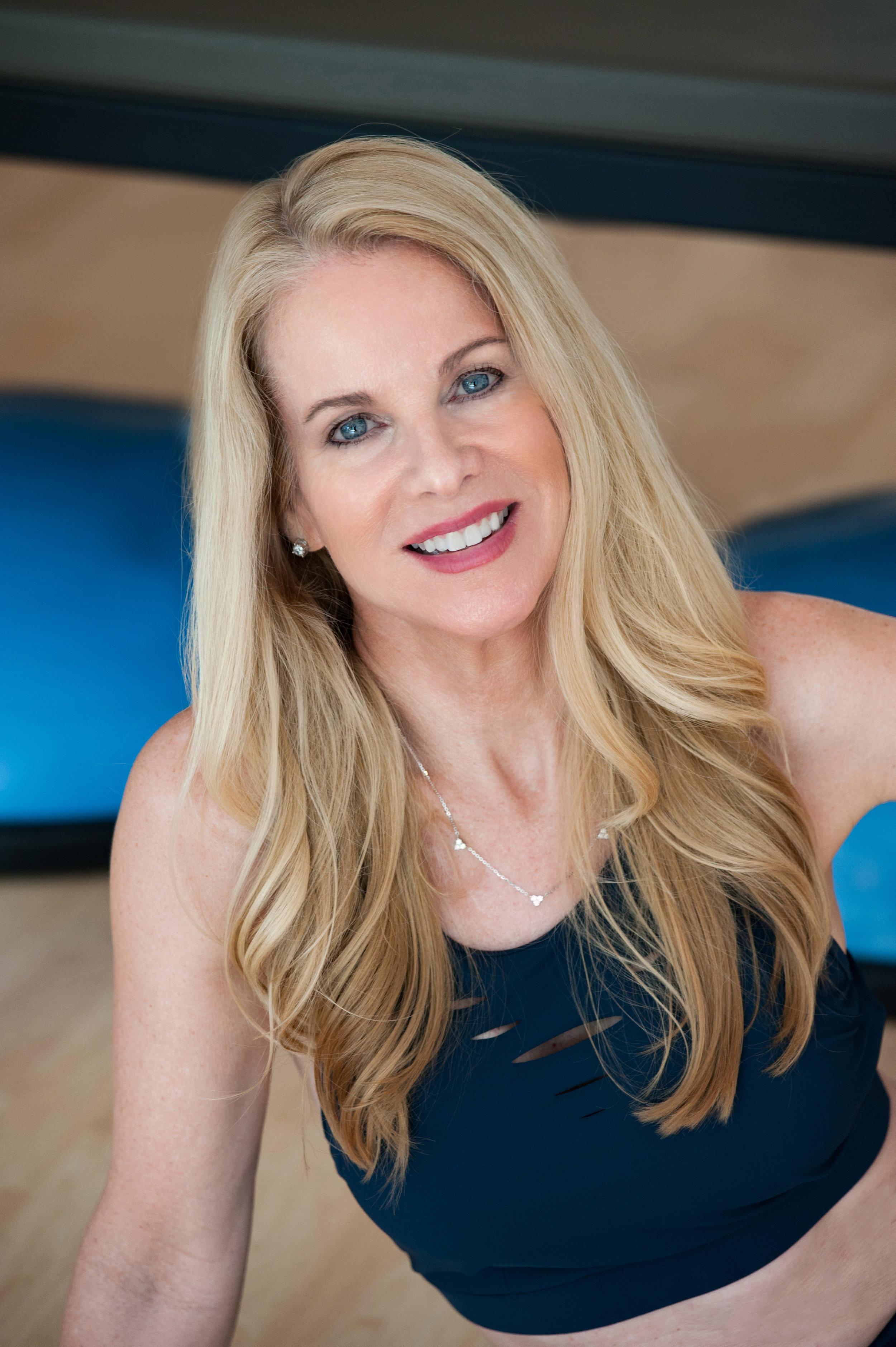 NINA DESLOGE-DAY, A STOTT PILATES® Certified Instructor. Owner of Pilates Works of Sarasota studio in Sarasota, FL.