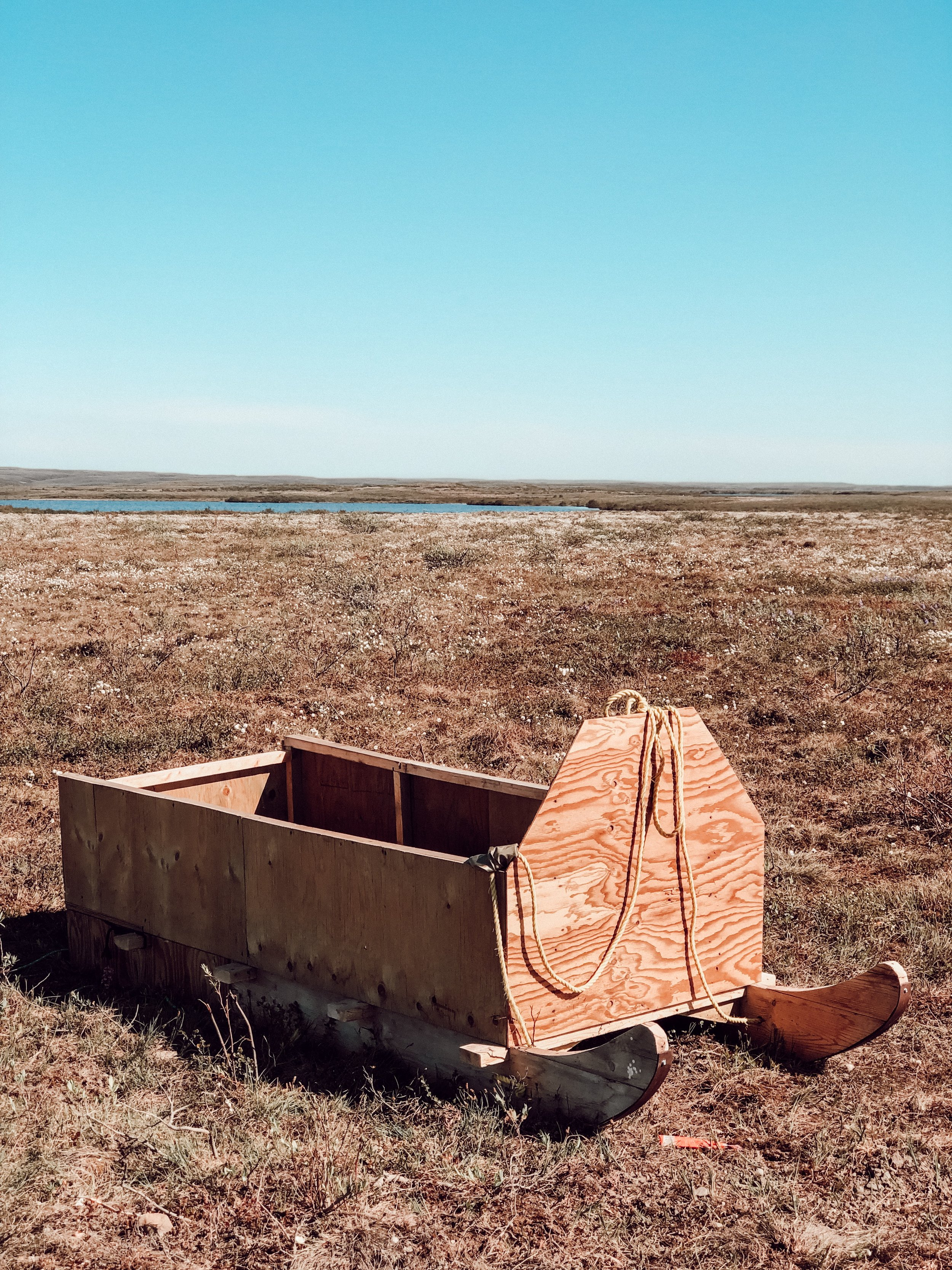 An abandoned sled in the tundra during summer in Canada's arctic
