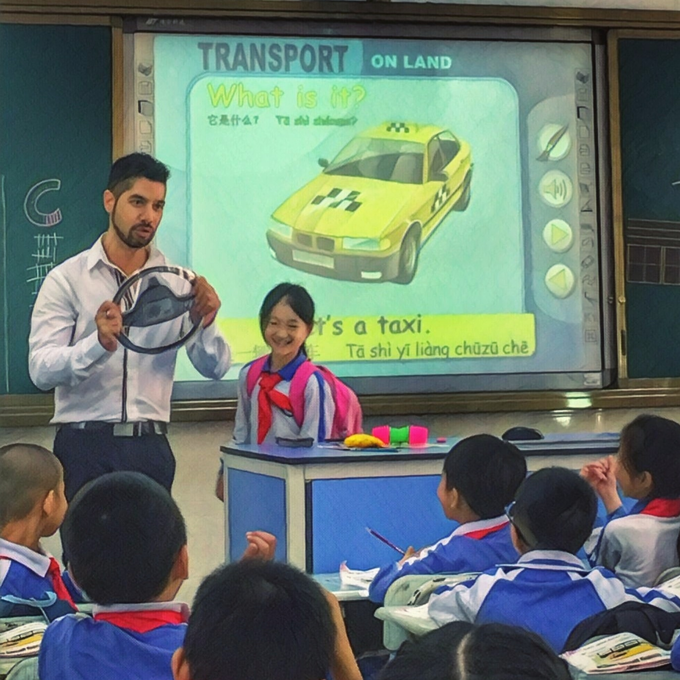 What is it? - April 3rd, 2018 - Shenzhen, ChinaToday, I was teaching my grade two class about the means of transport and I witnessed the funniest thing ever, which made me write this blog post. We started with bicycles, then cars, then buses, everything was going well until I put up the slide for a taxi.I asked them,