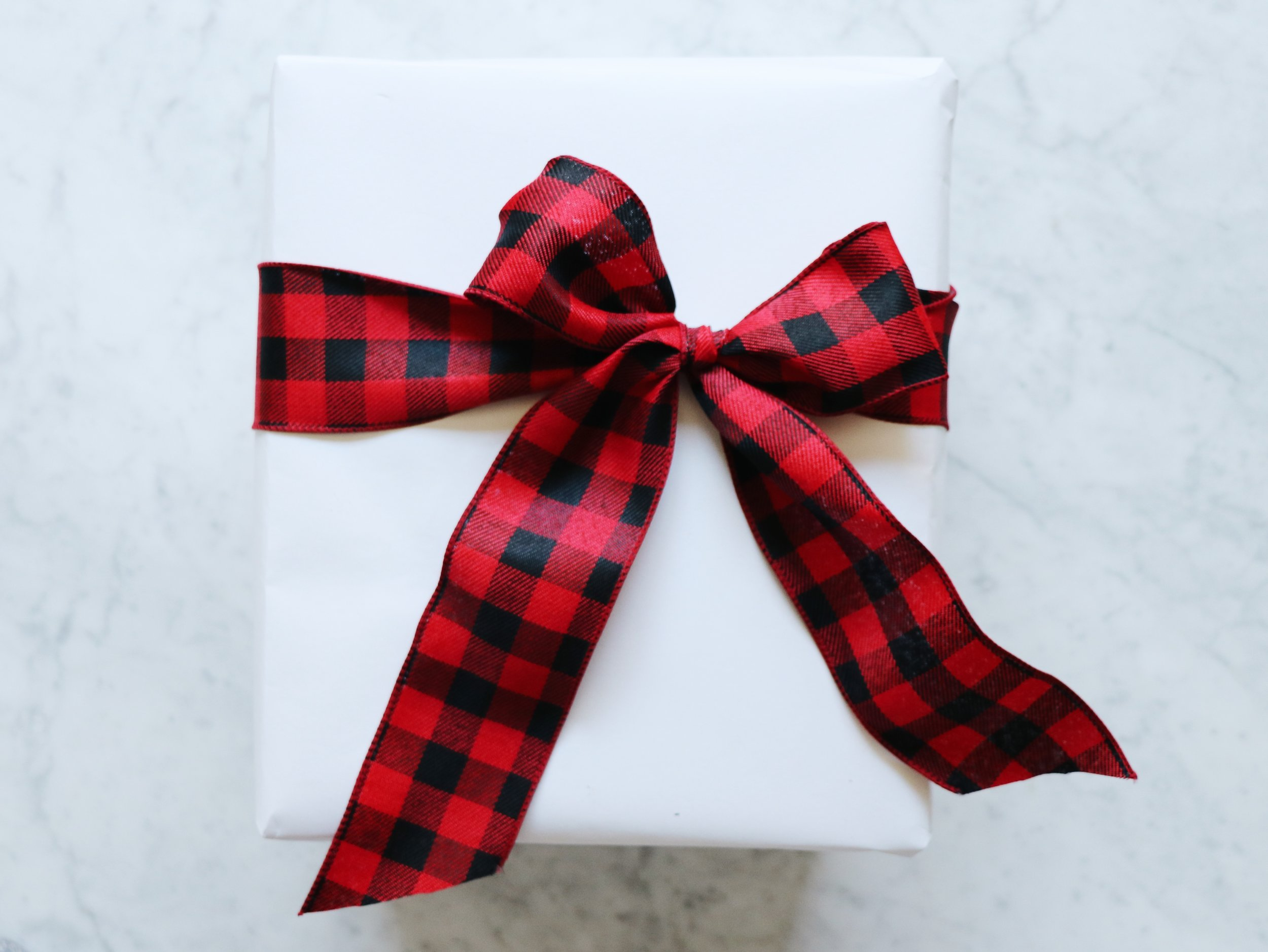 Red bow on white present