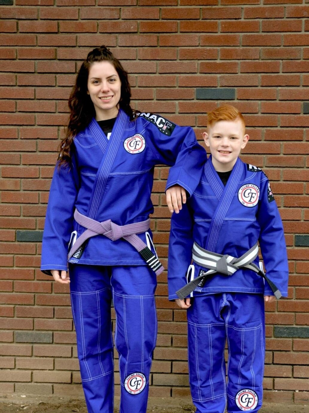Grey belt kids Champion Owen and Purple Belt Champion Christina in our one of a kind RNACF Gi's.