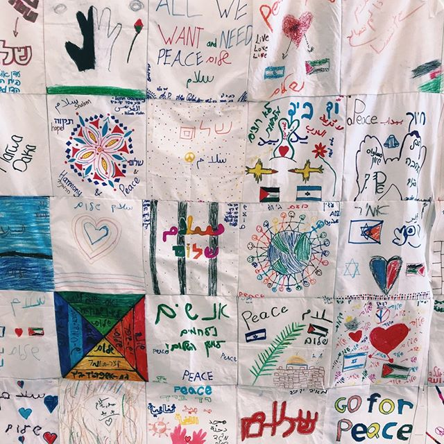 A quilt made by students at Jerusalem's Hand in Hand school, one of a small number of integrated bilingual schools in Israel where students of all backgrounds learn together in both Hebrew and Arabic. Tune into Episode 7 for more! . @handinhandschools #conflict #peace #Jerusalem #handinhand #yadbyad #palestine #israel #israeli #palestinian #education #israelipalestinianconflict #middleeast #politics #mindsofpeace #negotiation #peacetalk #popular #diplomacy #movement #intractable #intractablepodcast #podcast