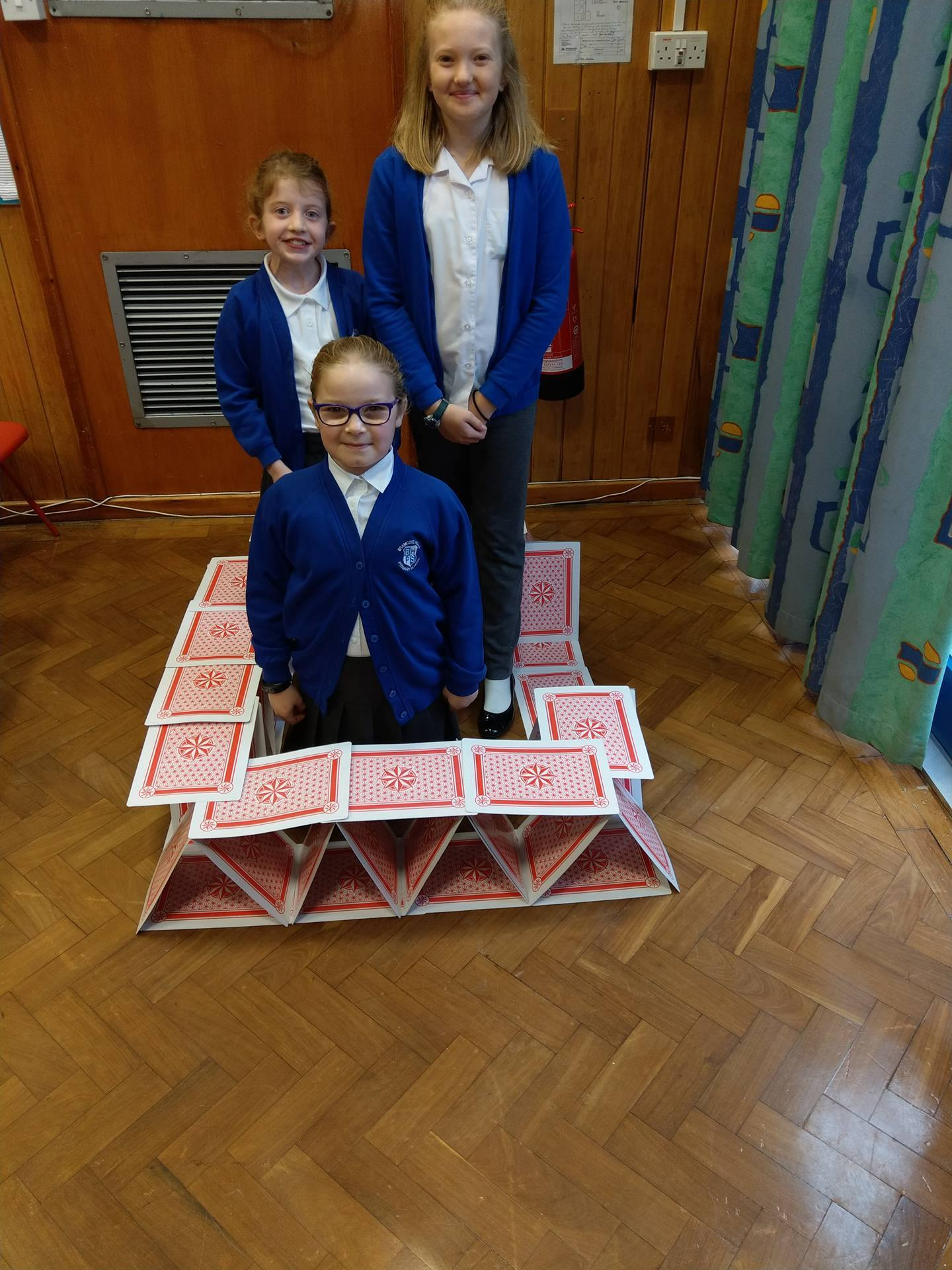 Castle for 3 made of cards.