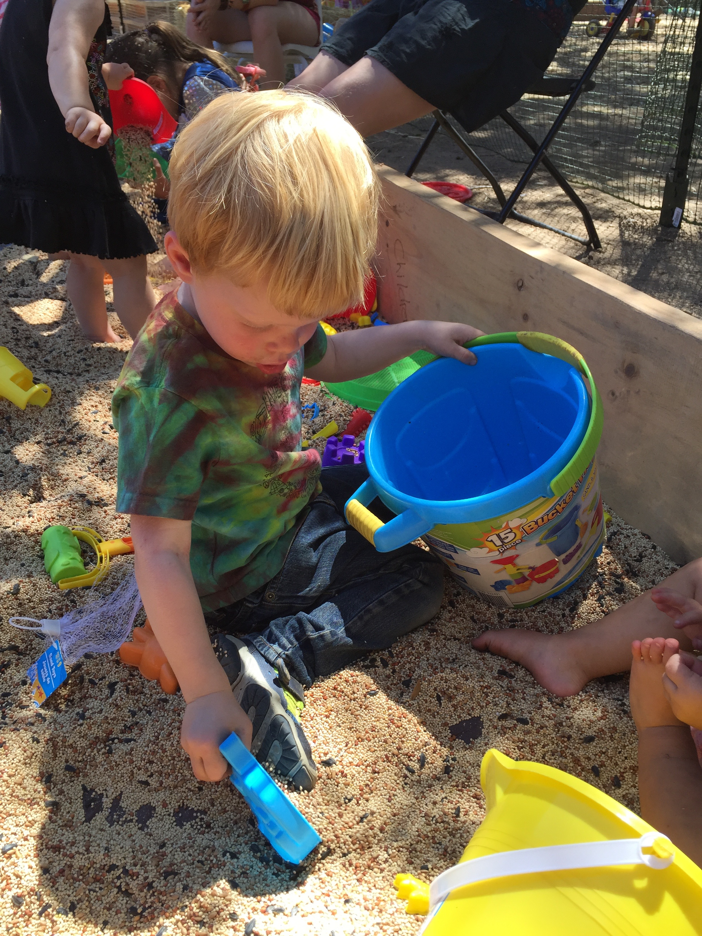 Little Acorns Toddler Oasis - The Toddler Oasis for our littlest Acorn Oakies includes toys and crafts. Returning is our popular birdseed box and lounging Adirondacks for parents.