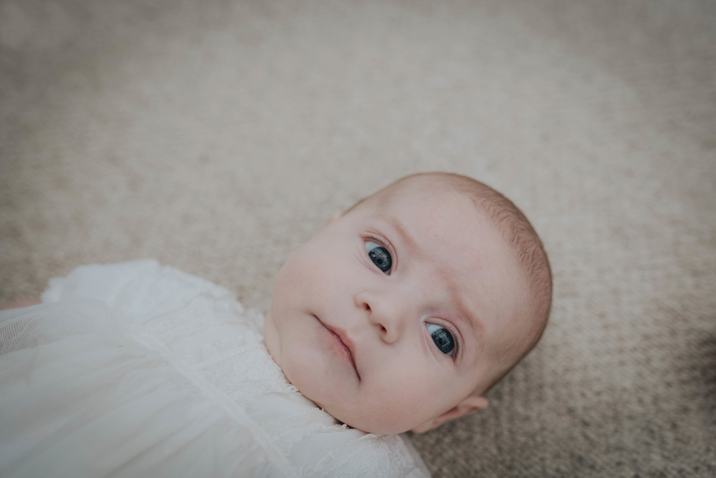 A portrait of newborn baby Harry looking directly into the camera.