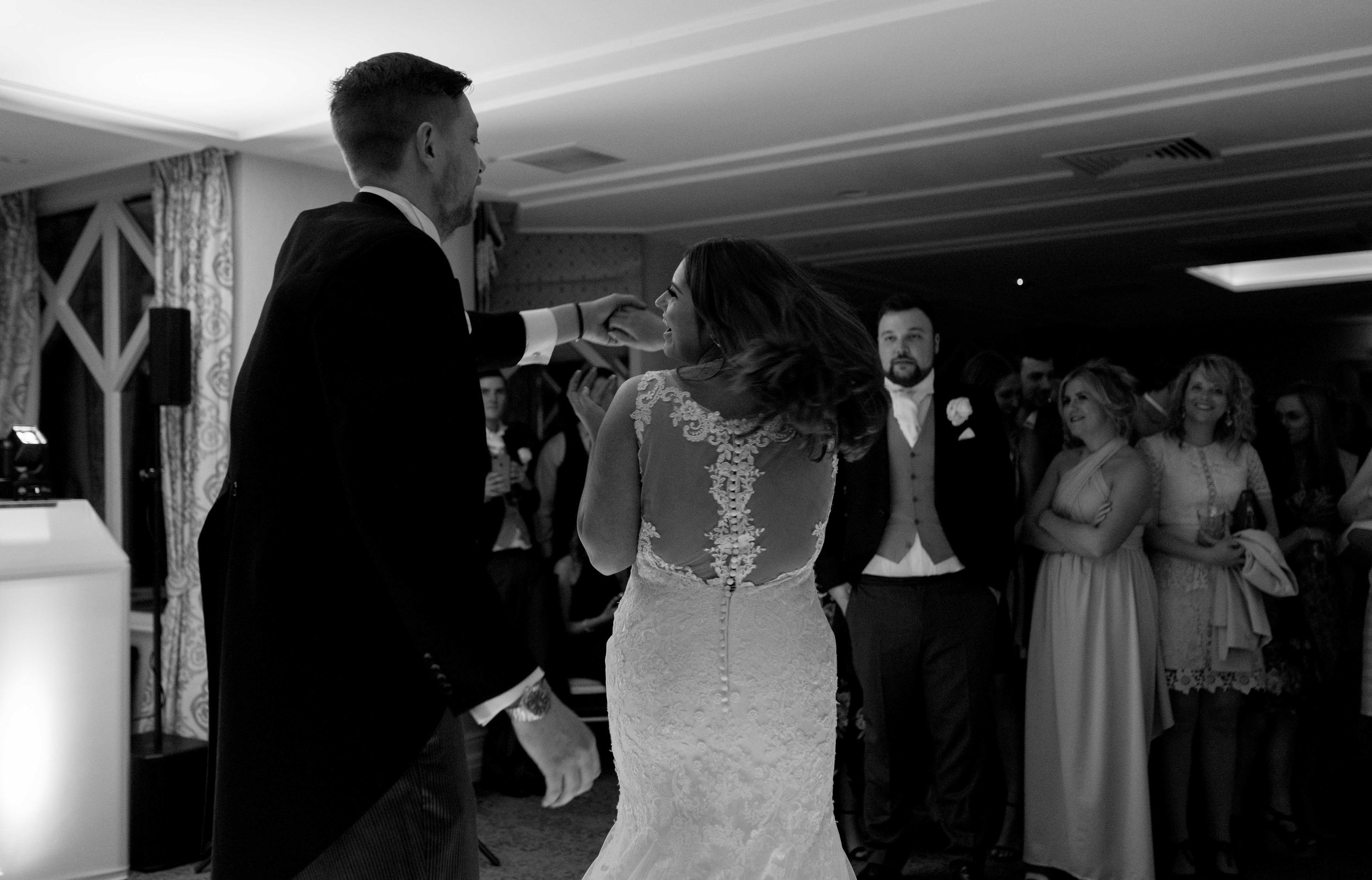 the bride and groom have their really smiley first dance