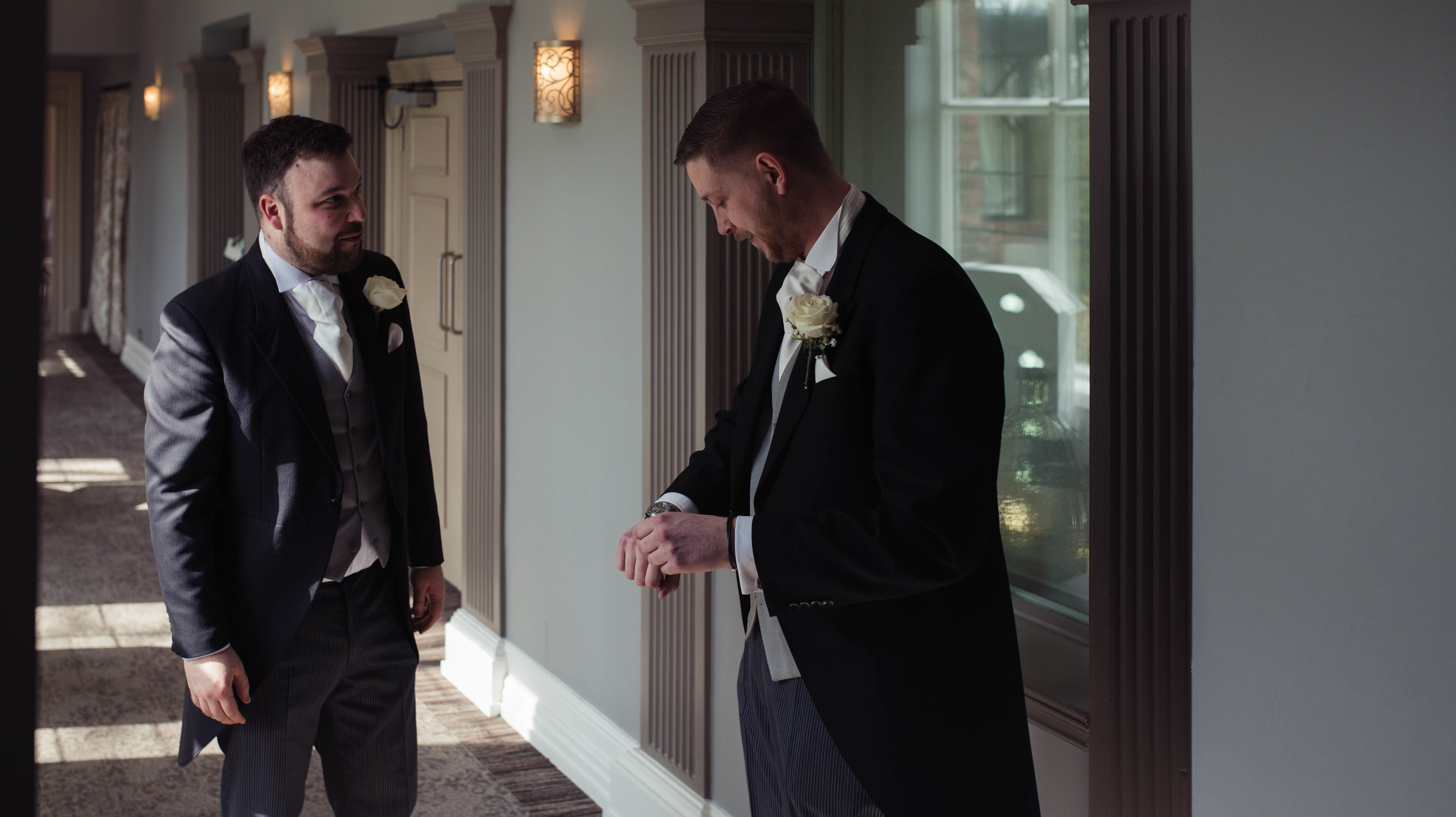 the best man gives the groom a watch as a present from his bride to be