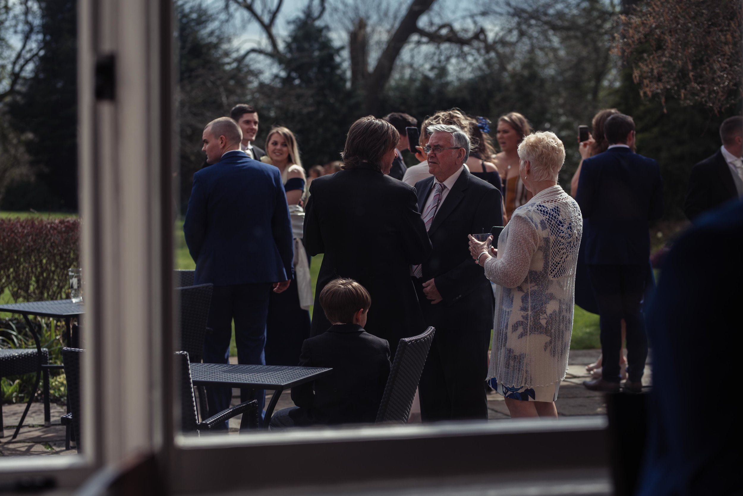 guests gather outside the venue for their cumbria wedding photography