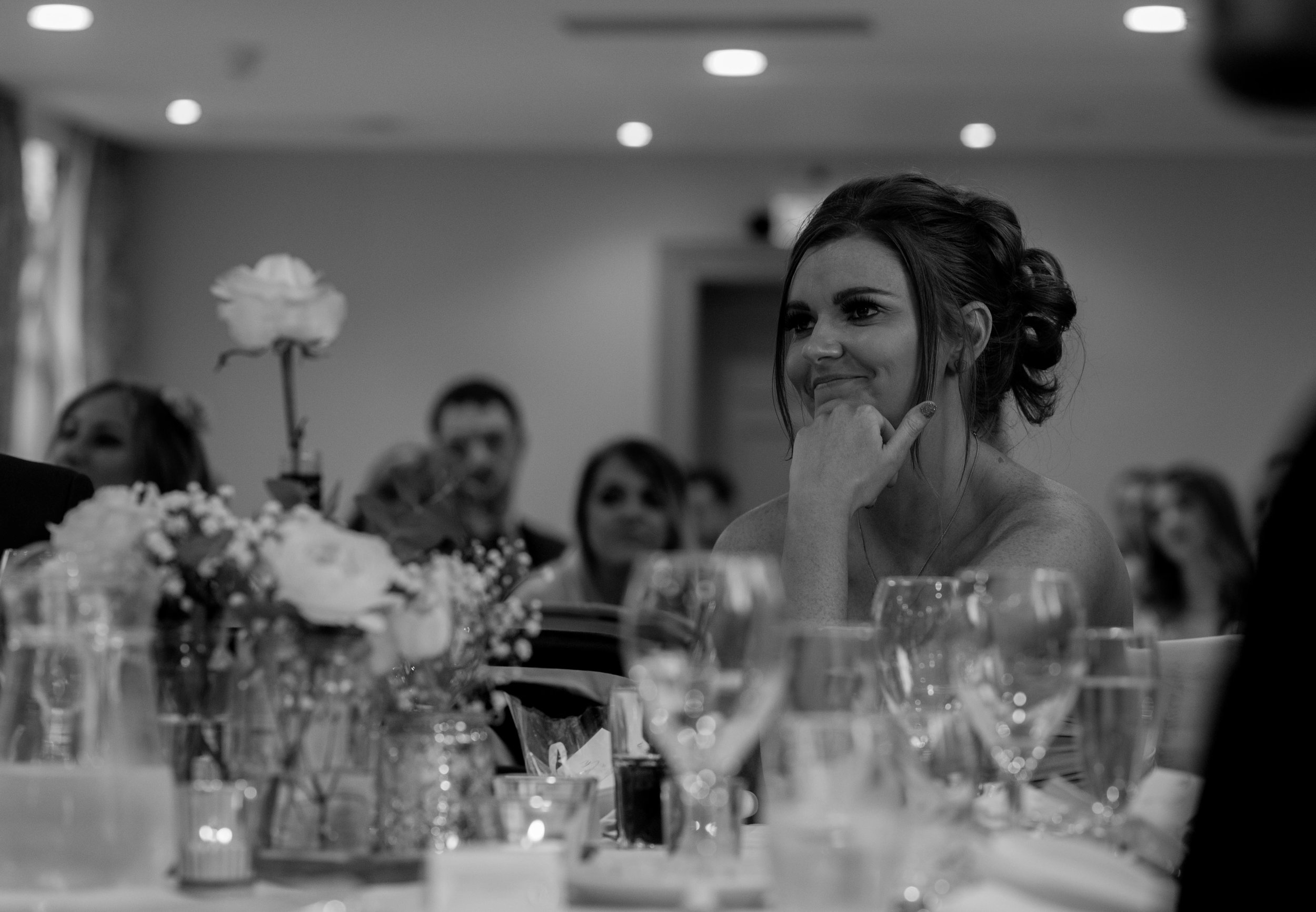 a bridesmaid looks towards the top table in a emotional moment of the speeches
