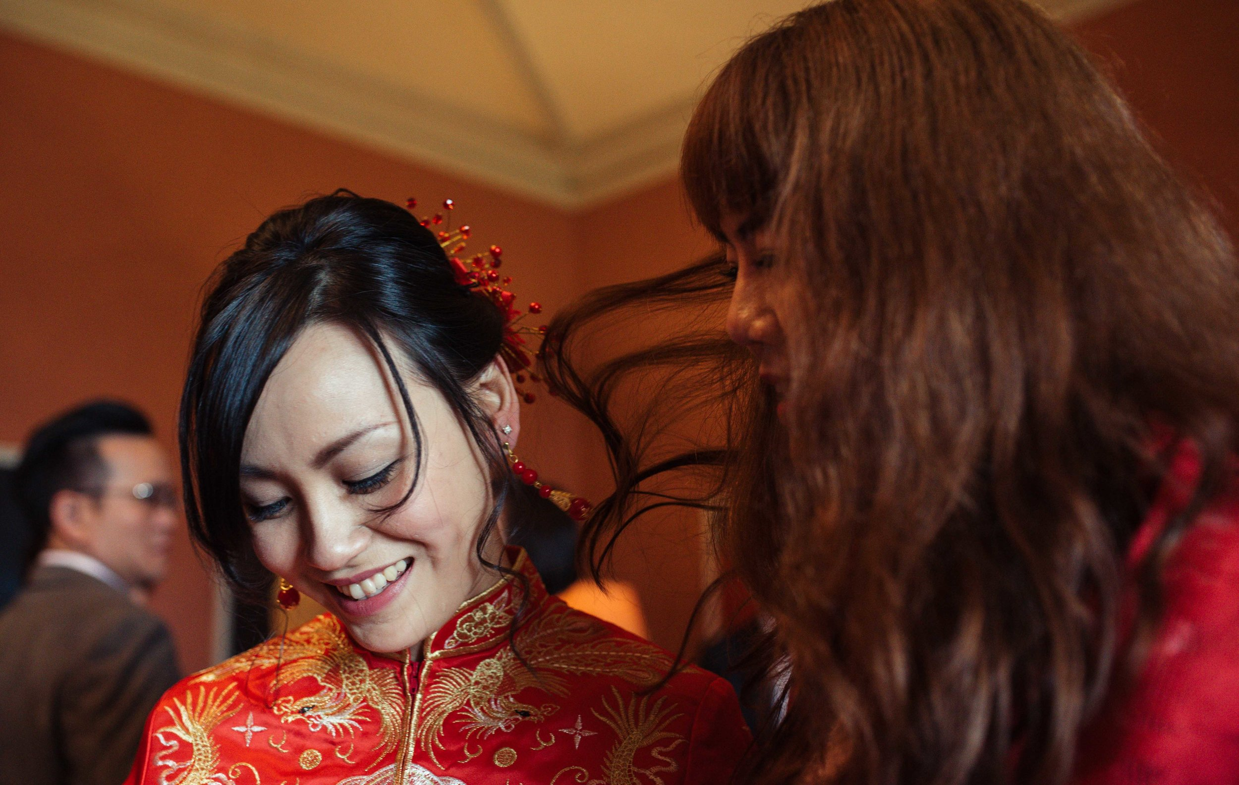 the bride looks down at the floor during the Chinese tea ceremony