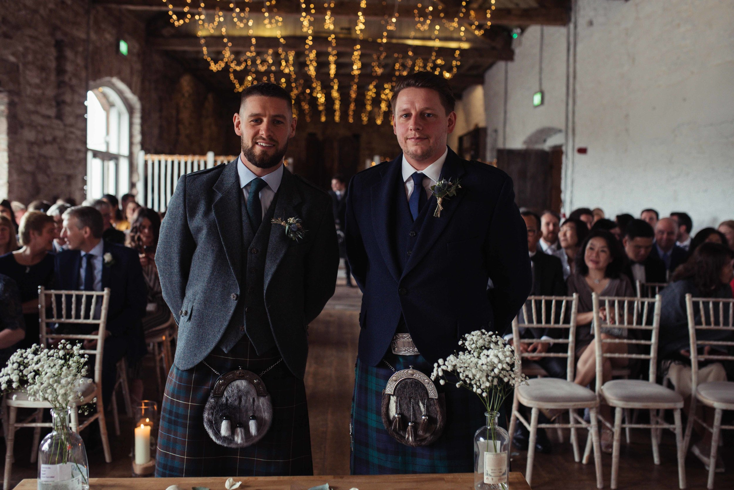 The groom and his best man stand ready and waiting for the bride to make her entrance