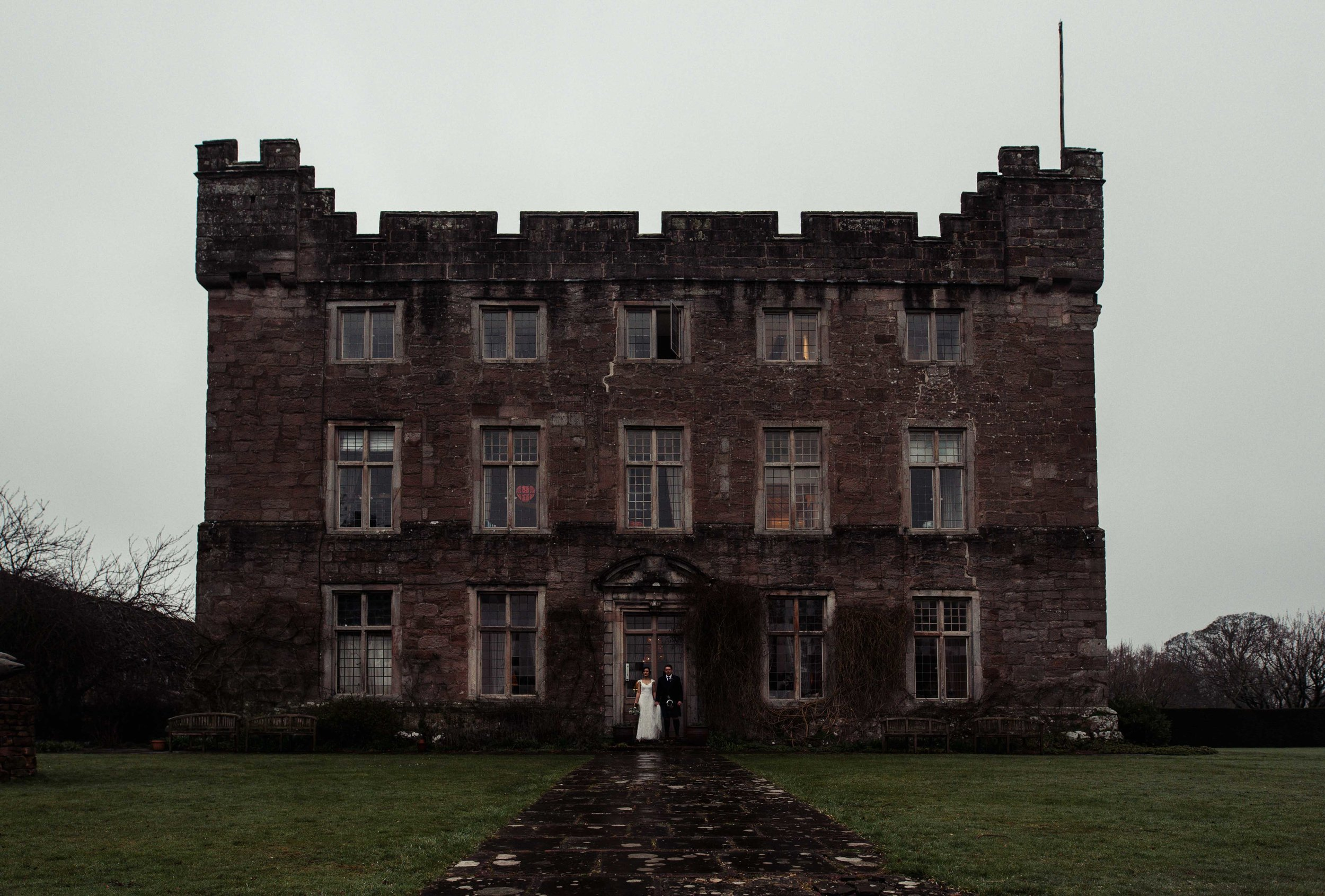 Askham Hall with the wedding couple in front