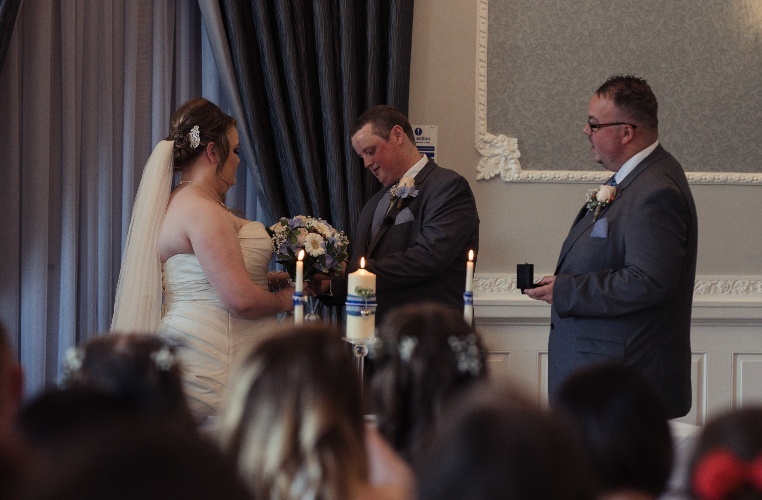 The bride and groom exchange their rings during the wedding ceremony