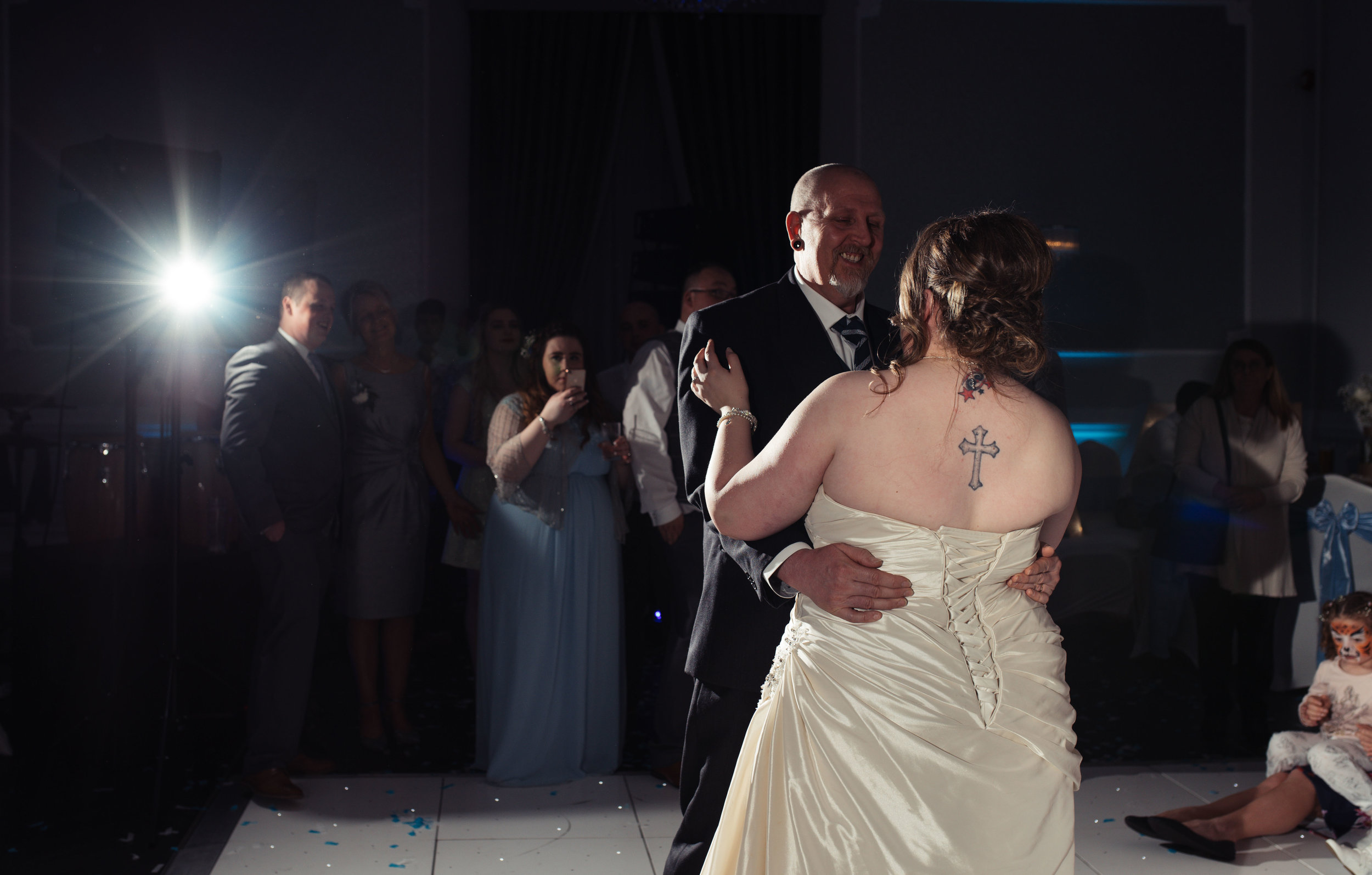 The bride has a dance with her father during the evening wedding reception