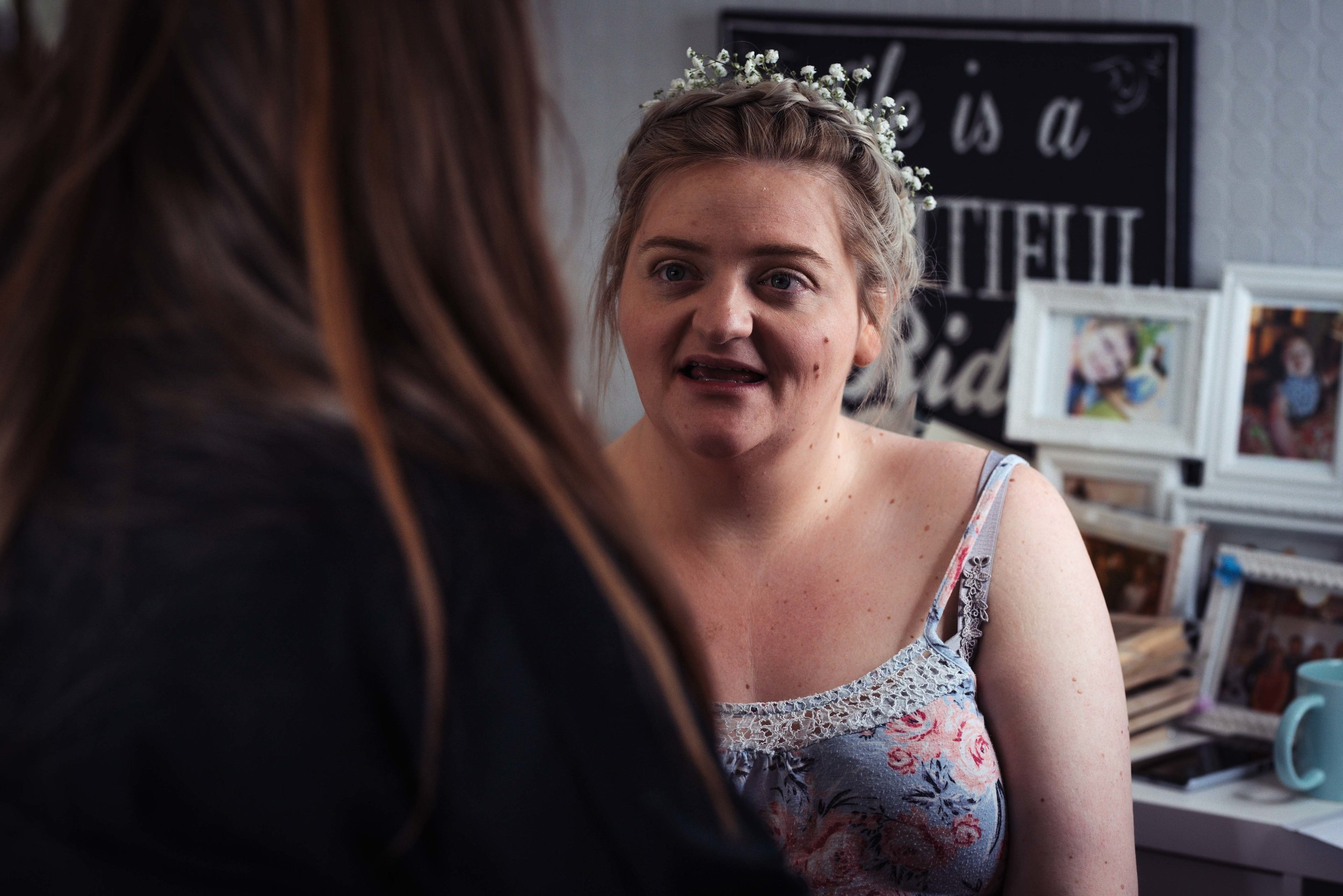 Bride having her makeup done before the wedding