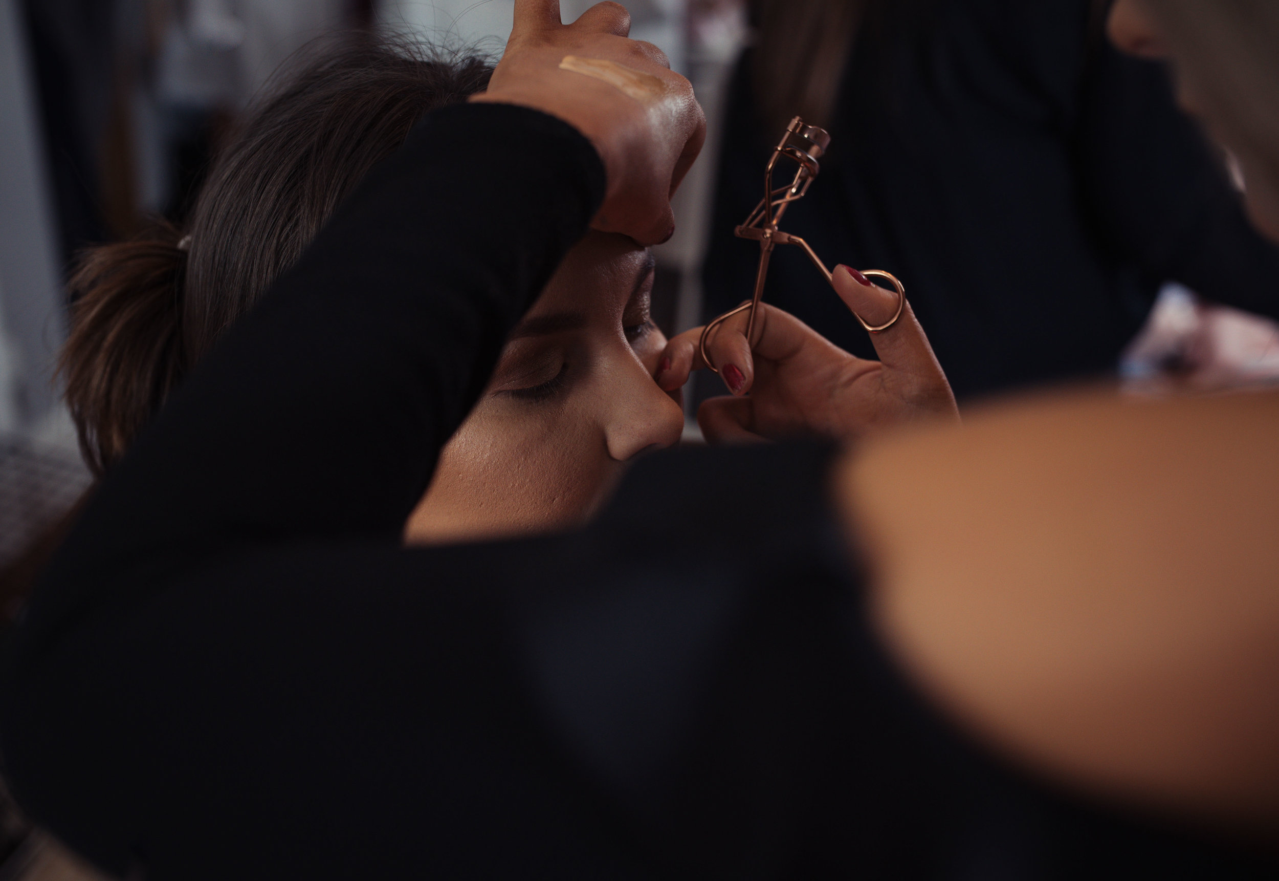 Close up shot of the bridesmaid getting her makeup done