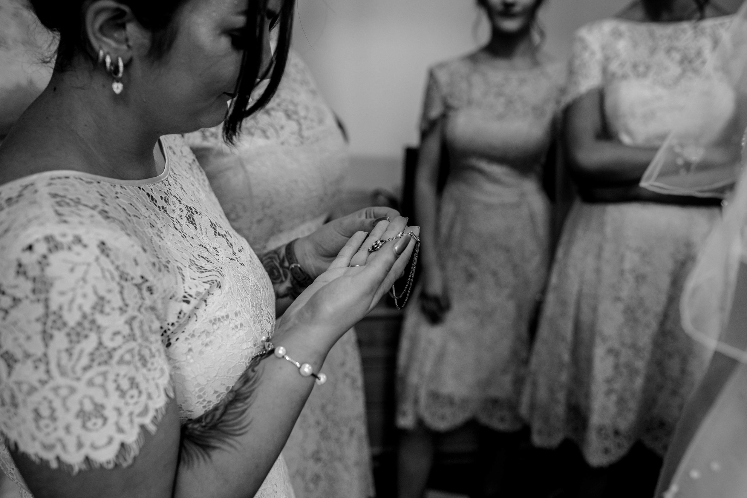 A bridesmaid sorts out the brides necklace