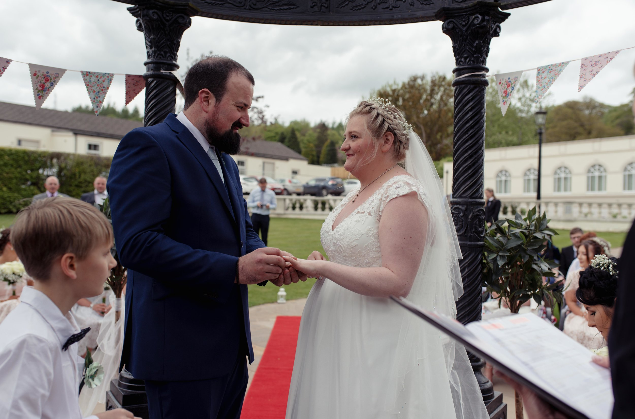 The bride and groom exchange vows in their Cumbria wedding