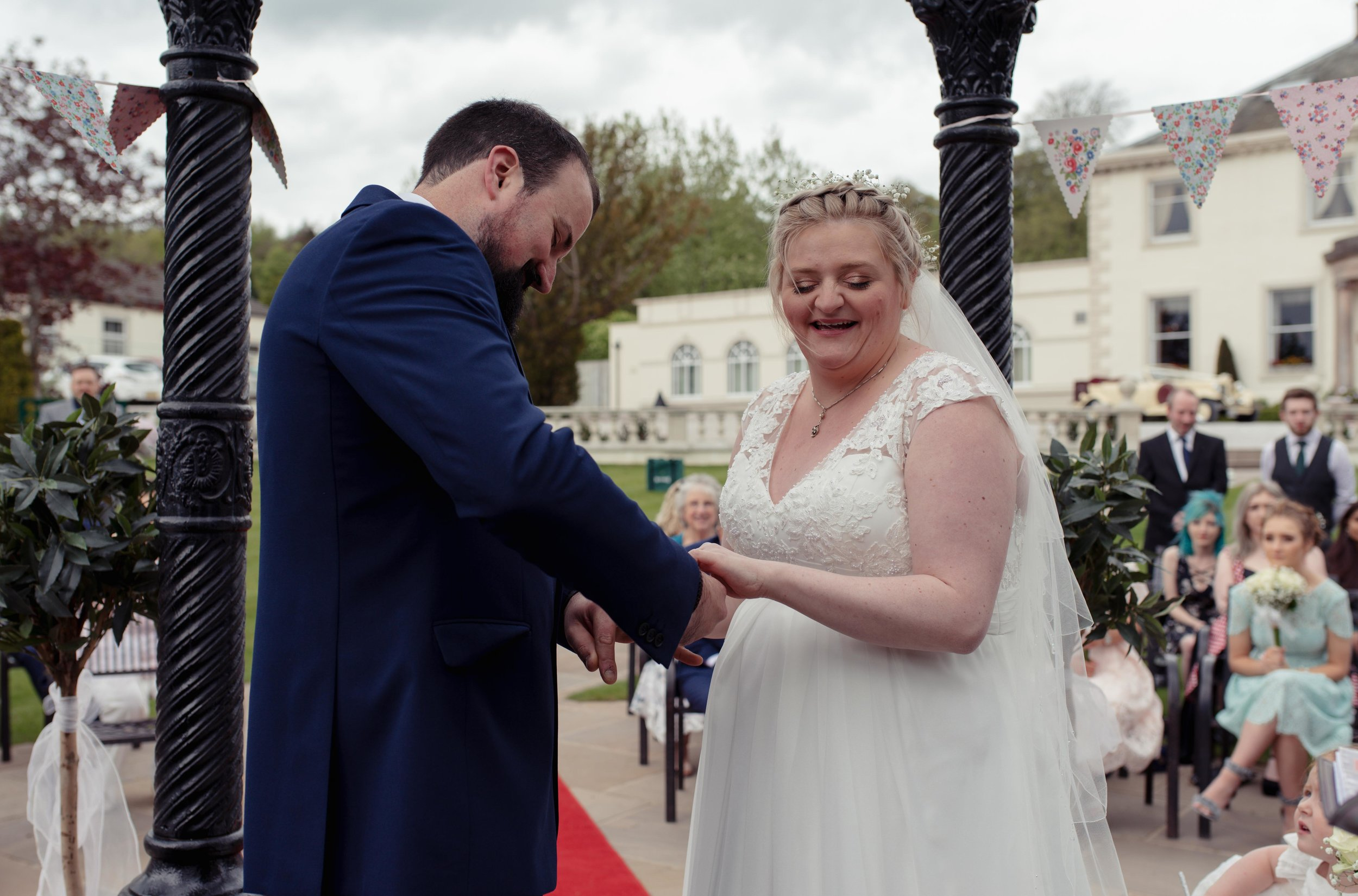 The bride and groom exchange their rings together