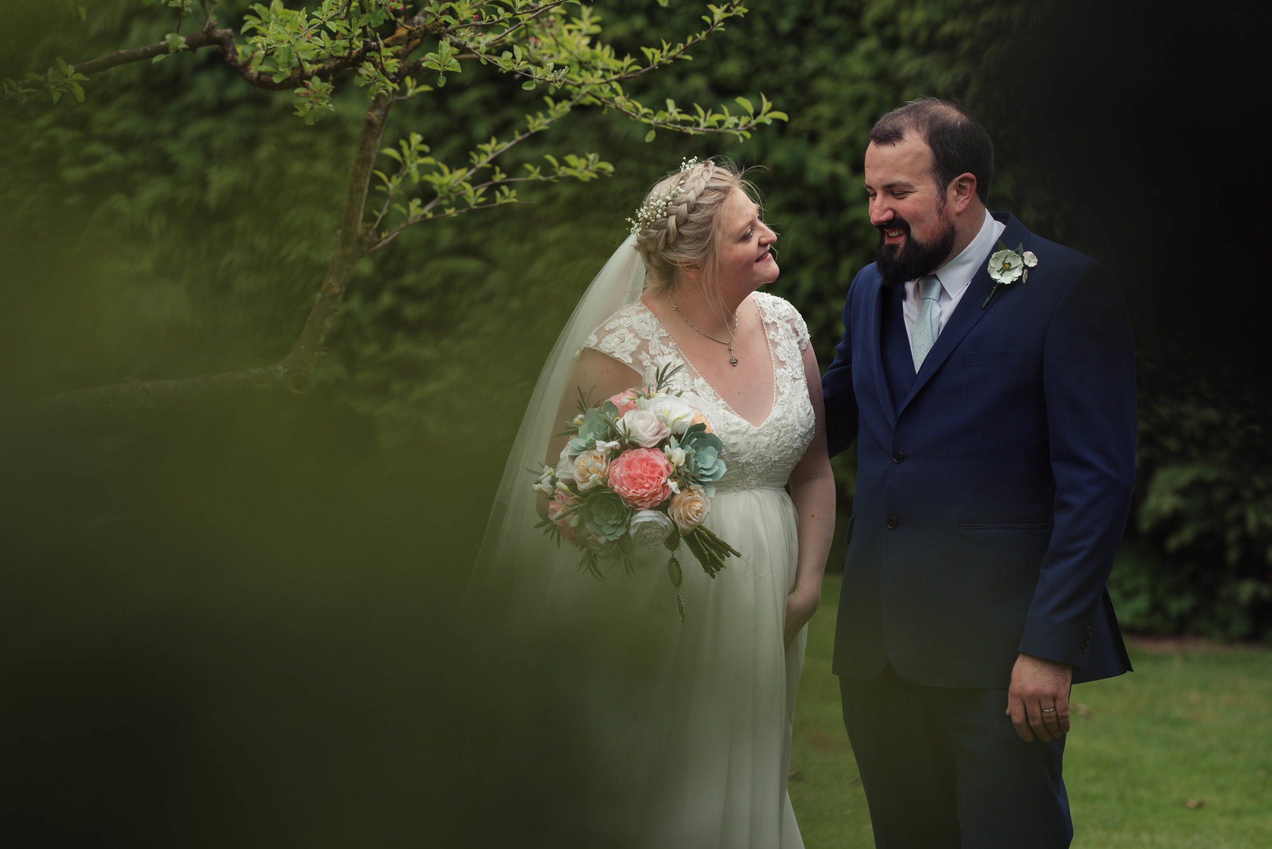 The bride and groom pose for their cumbria wedding photography