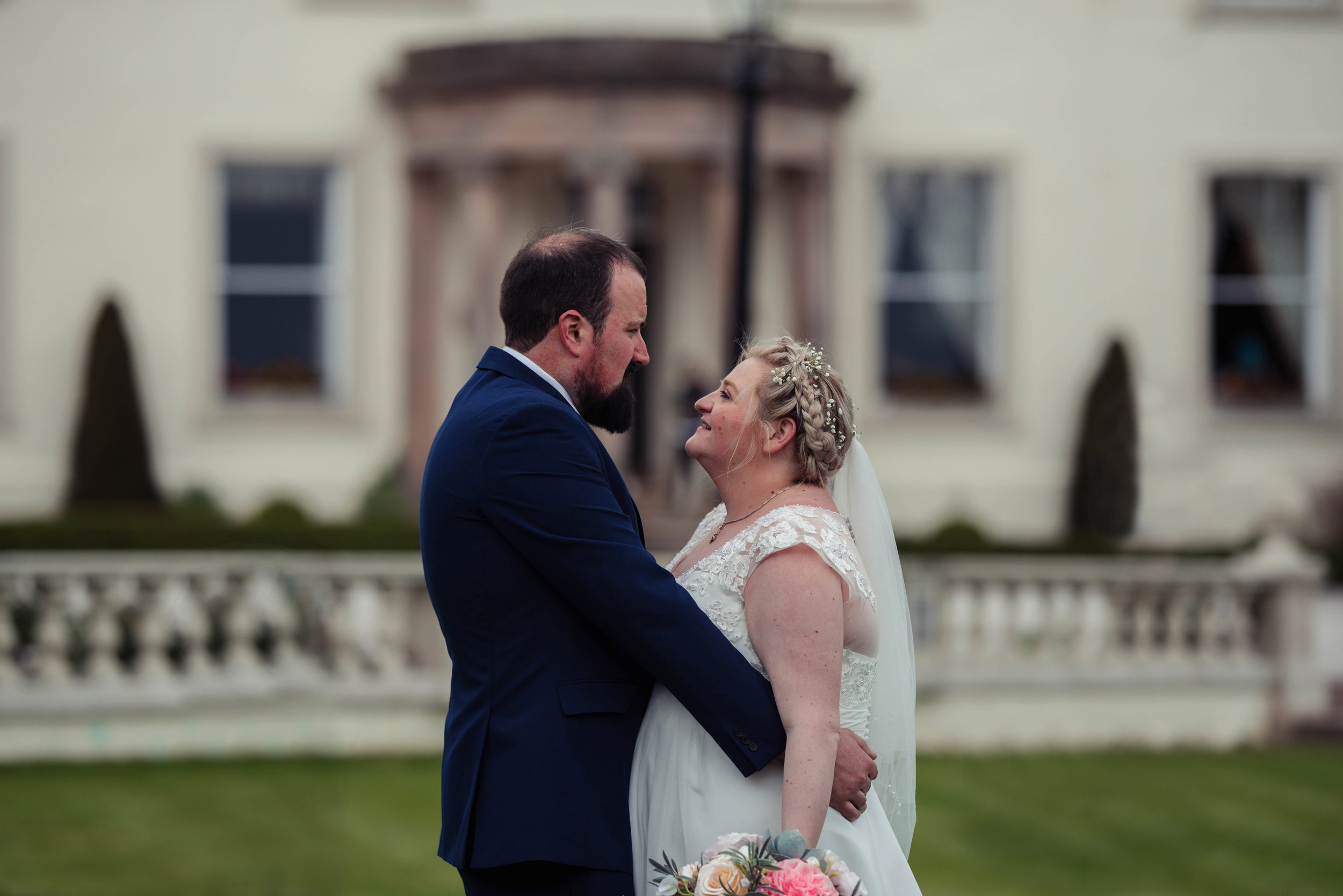 The bride and groom have a giggle during their wedding photography portraits