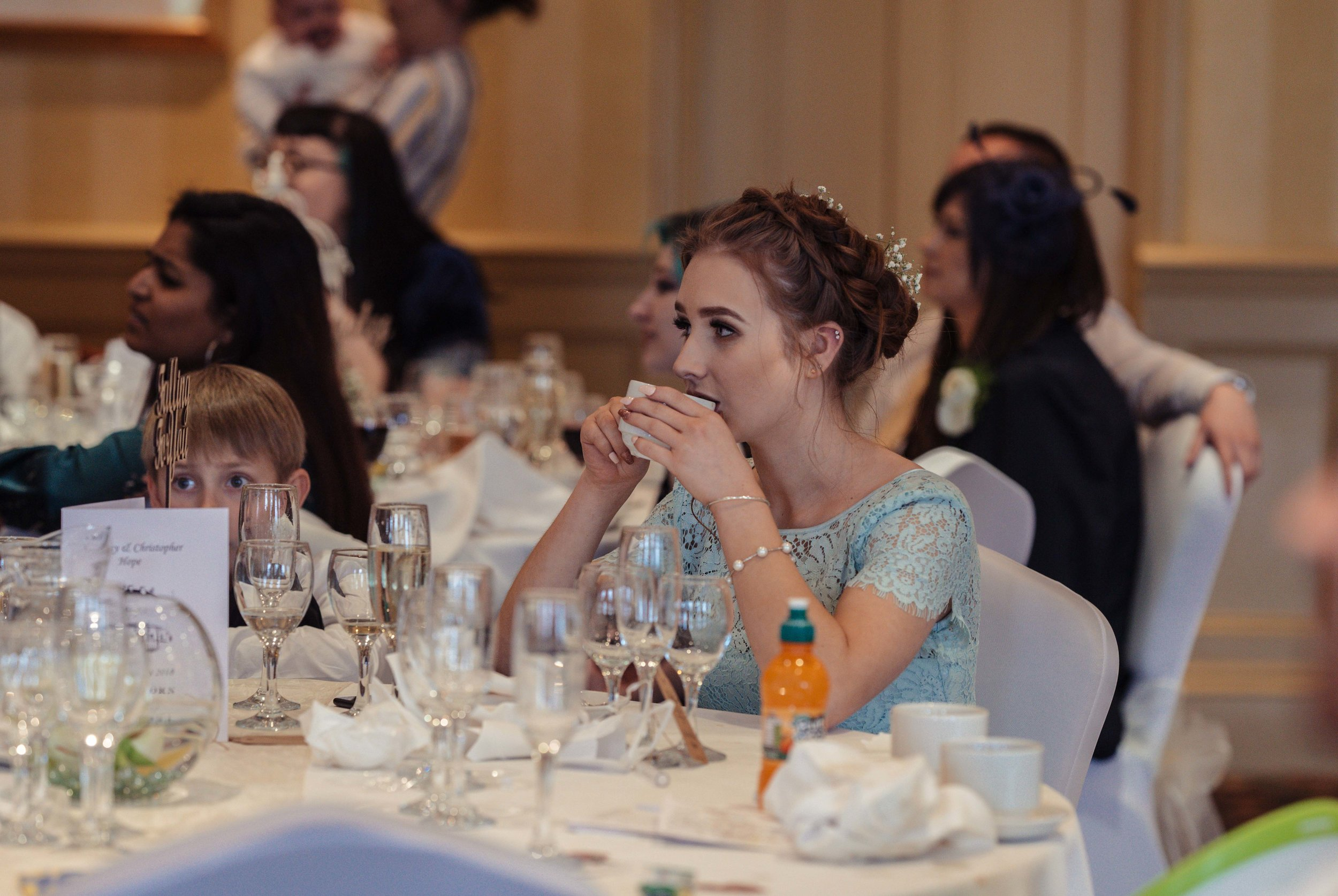 A bridesmaid listens to the speeches