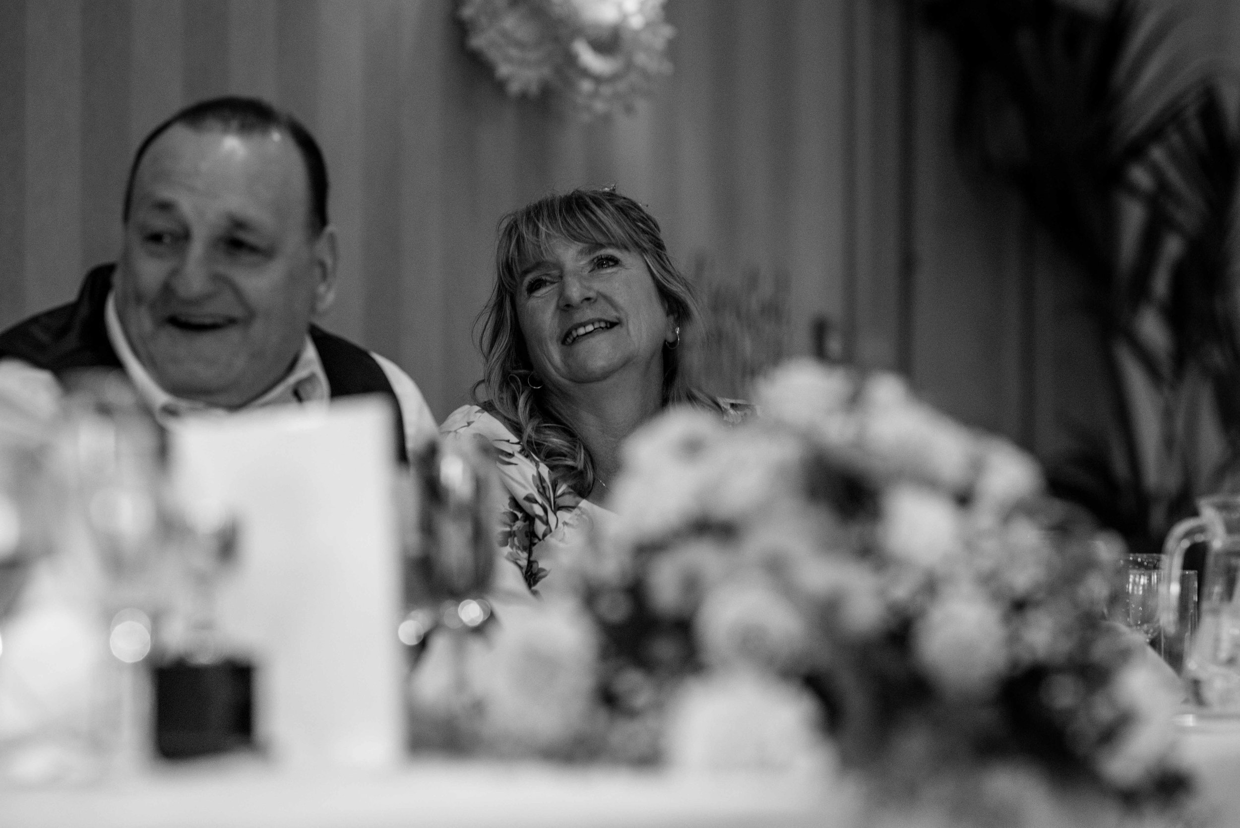 The brides mother looks up at her new son in law during the speeches