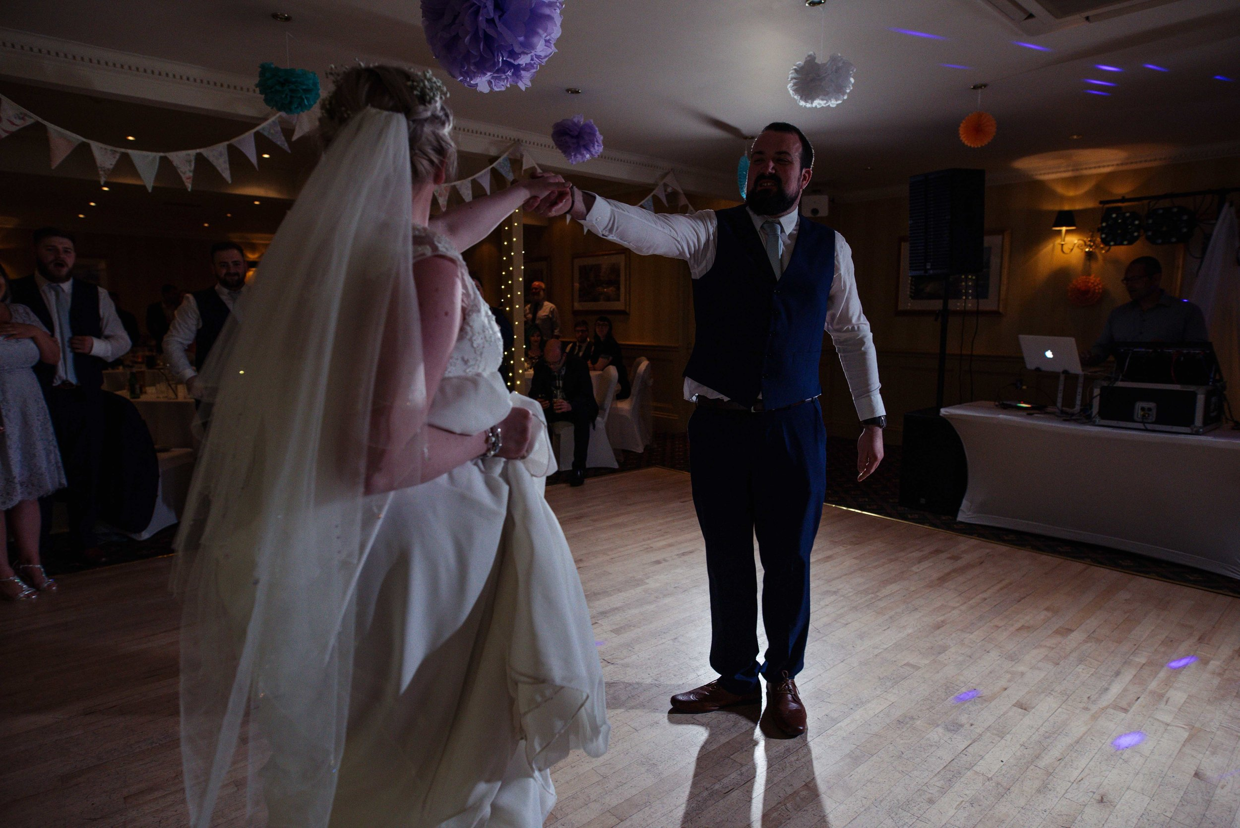 The groom is visible during the bride and grooms first dance together