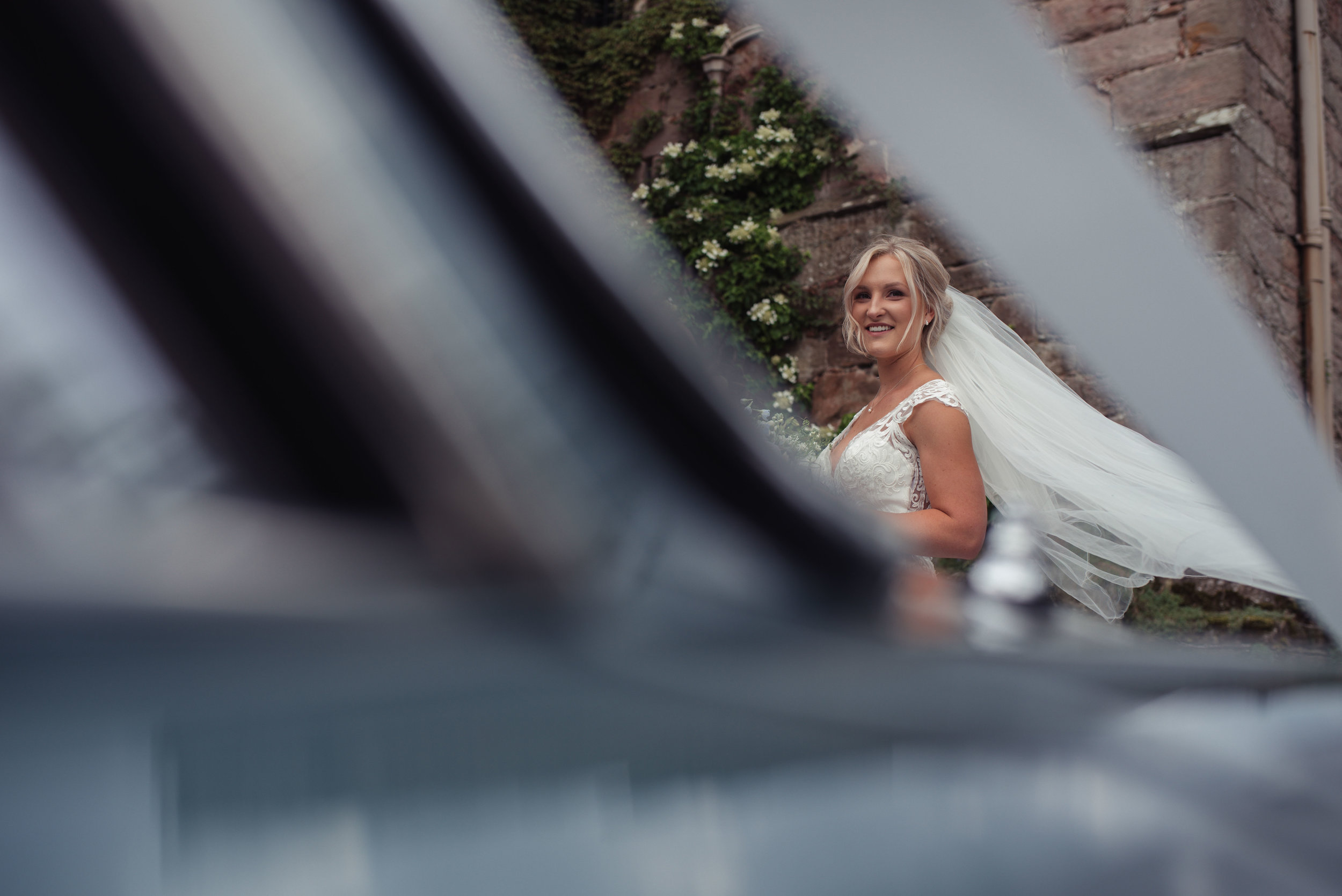 the bride looks at guests walking into the reception at askham hall