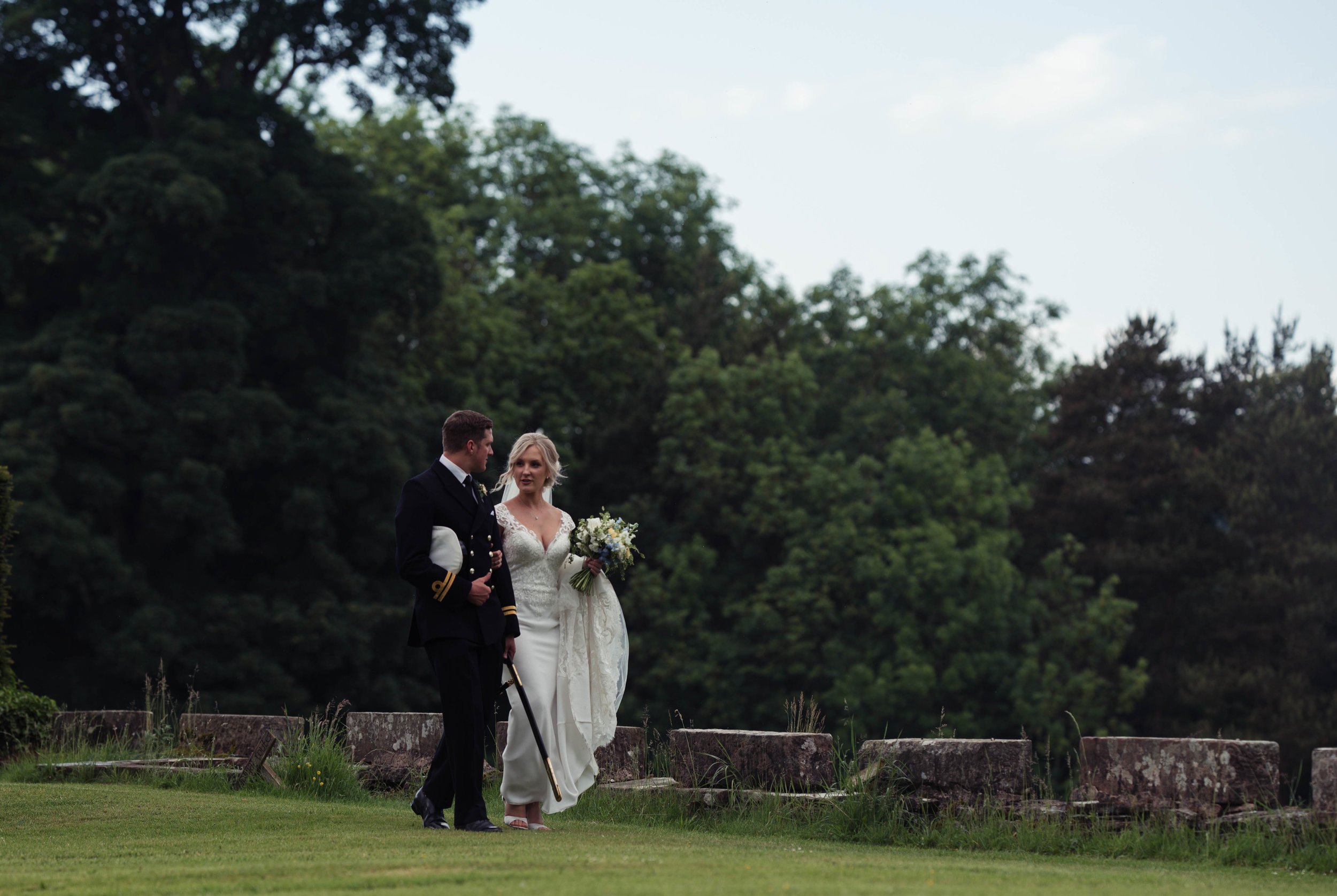 The bride and groom have a walk around the grounds at Askham Hall
