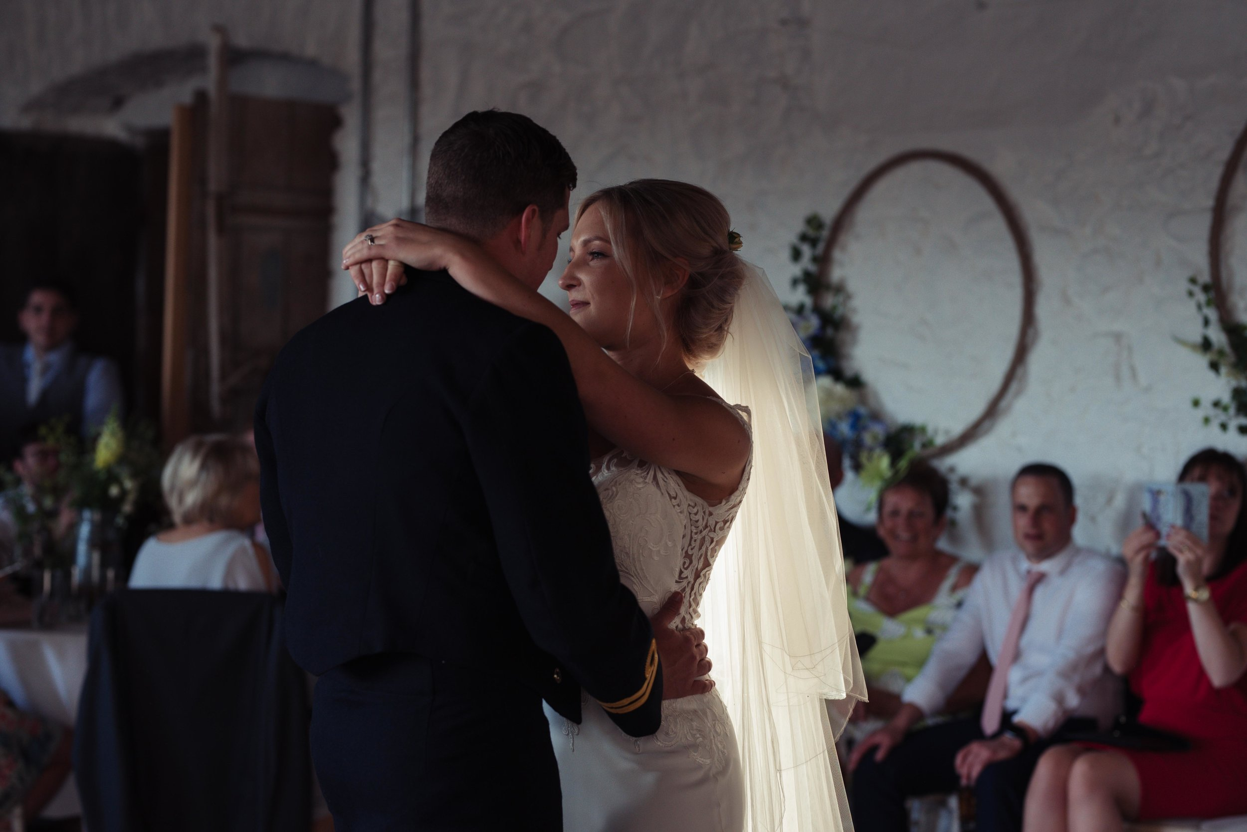 A sincere look of love during the bride and grooms first dance together